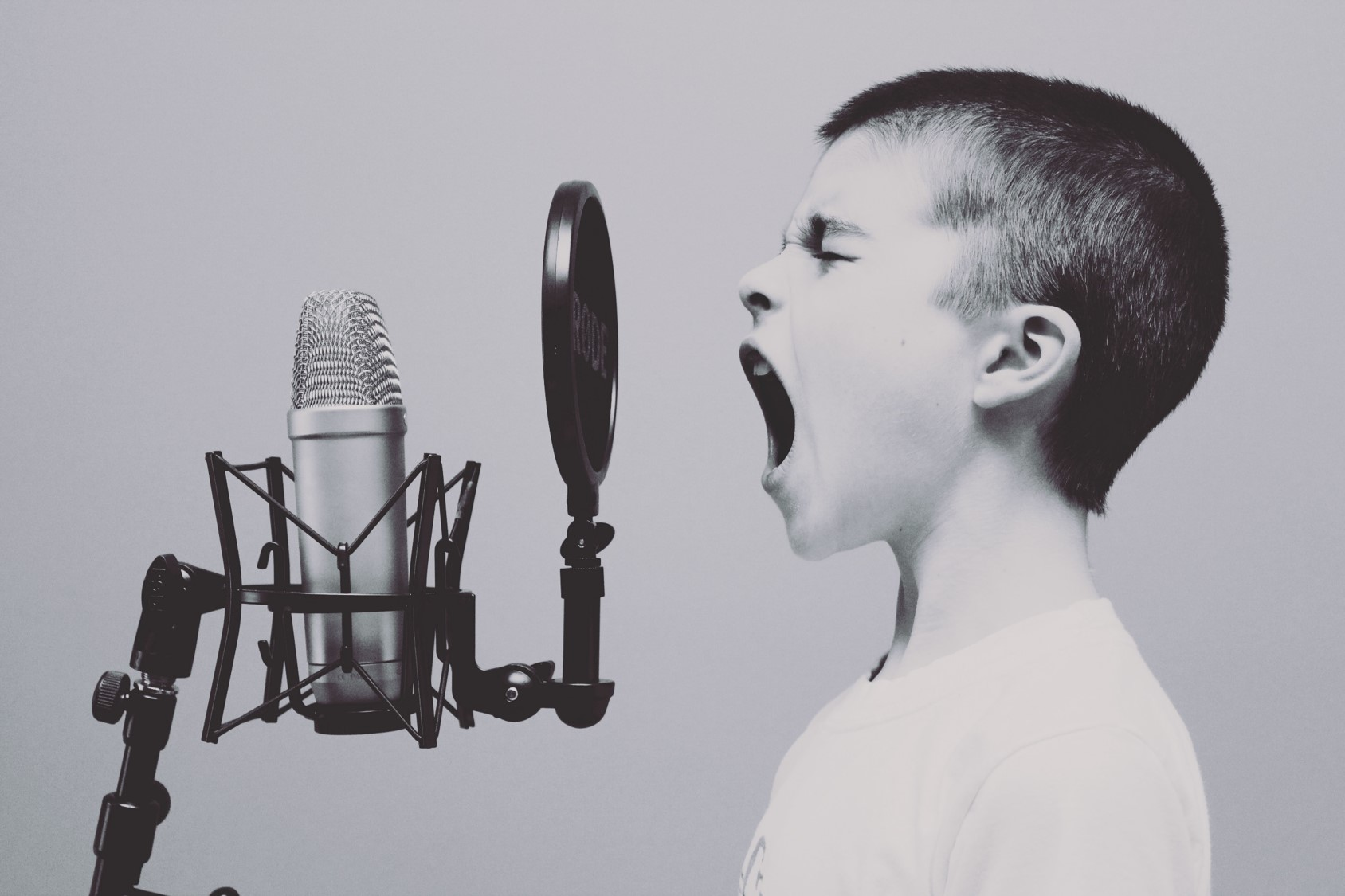 Boy shouting on mic Speak Out.jpg