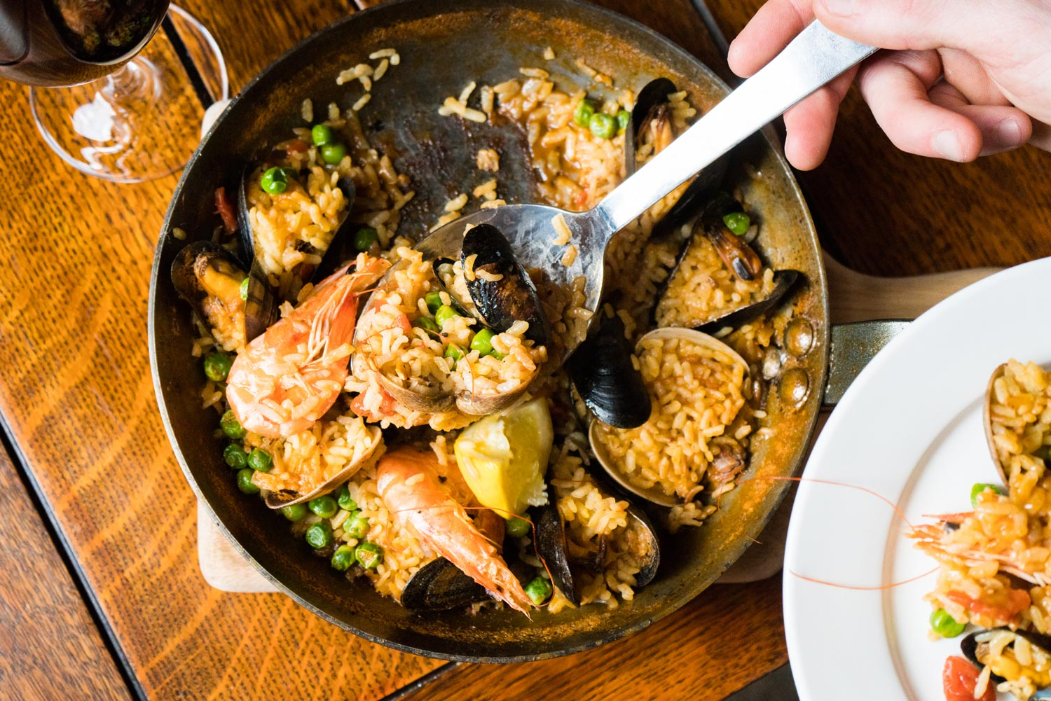 Seafood paella and wine