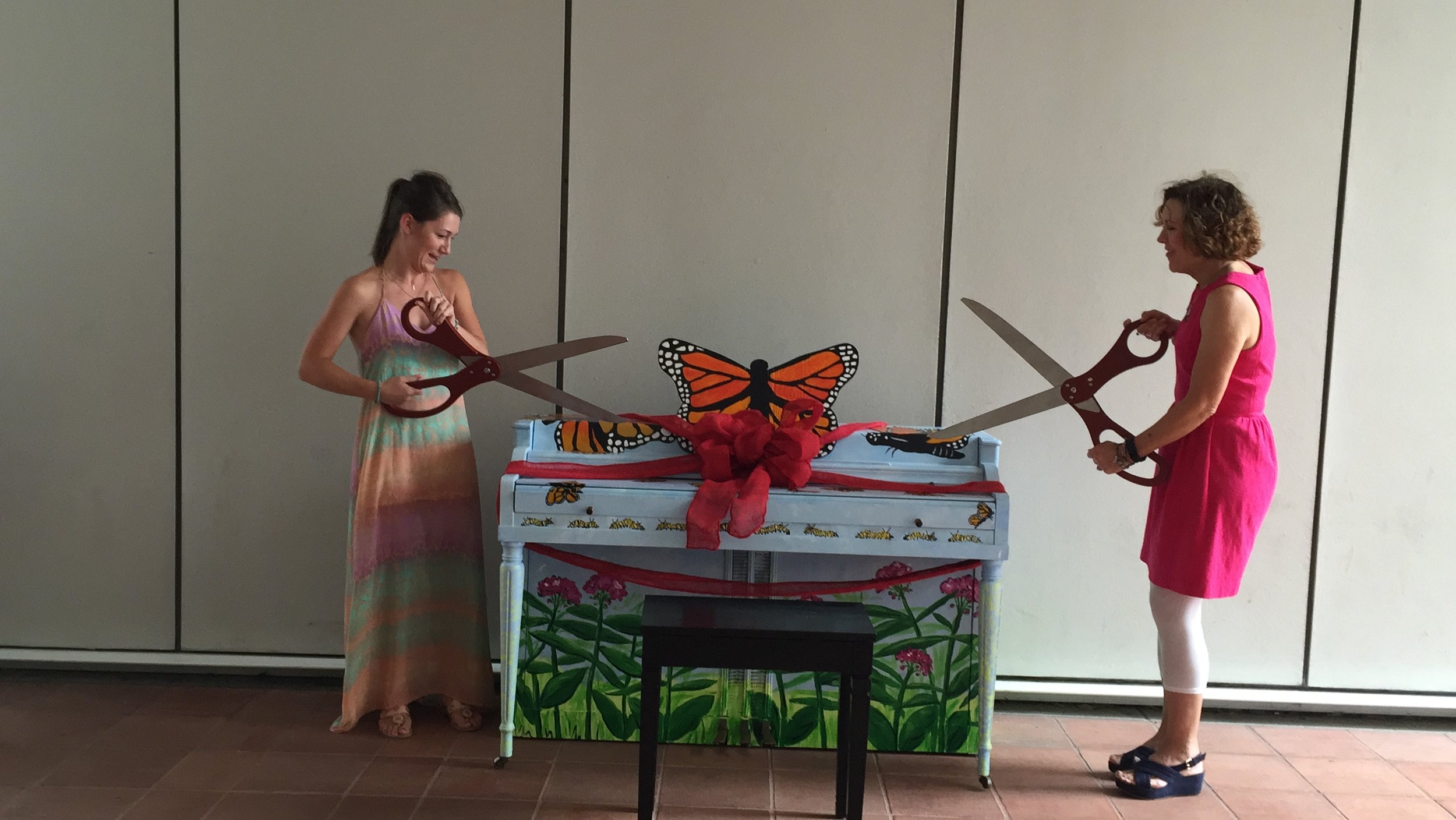 """artists courtney denis and theresa dean cut the ribbon on """"carly"""" at the woodruff arts center."""