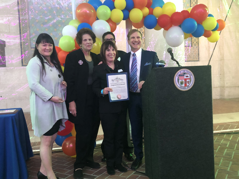 BABCNC President,  Robin Greenberg, accepts the award from City Controller, Ron Galperin, and EmpowerLA's Gracie Liu