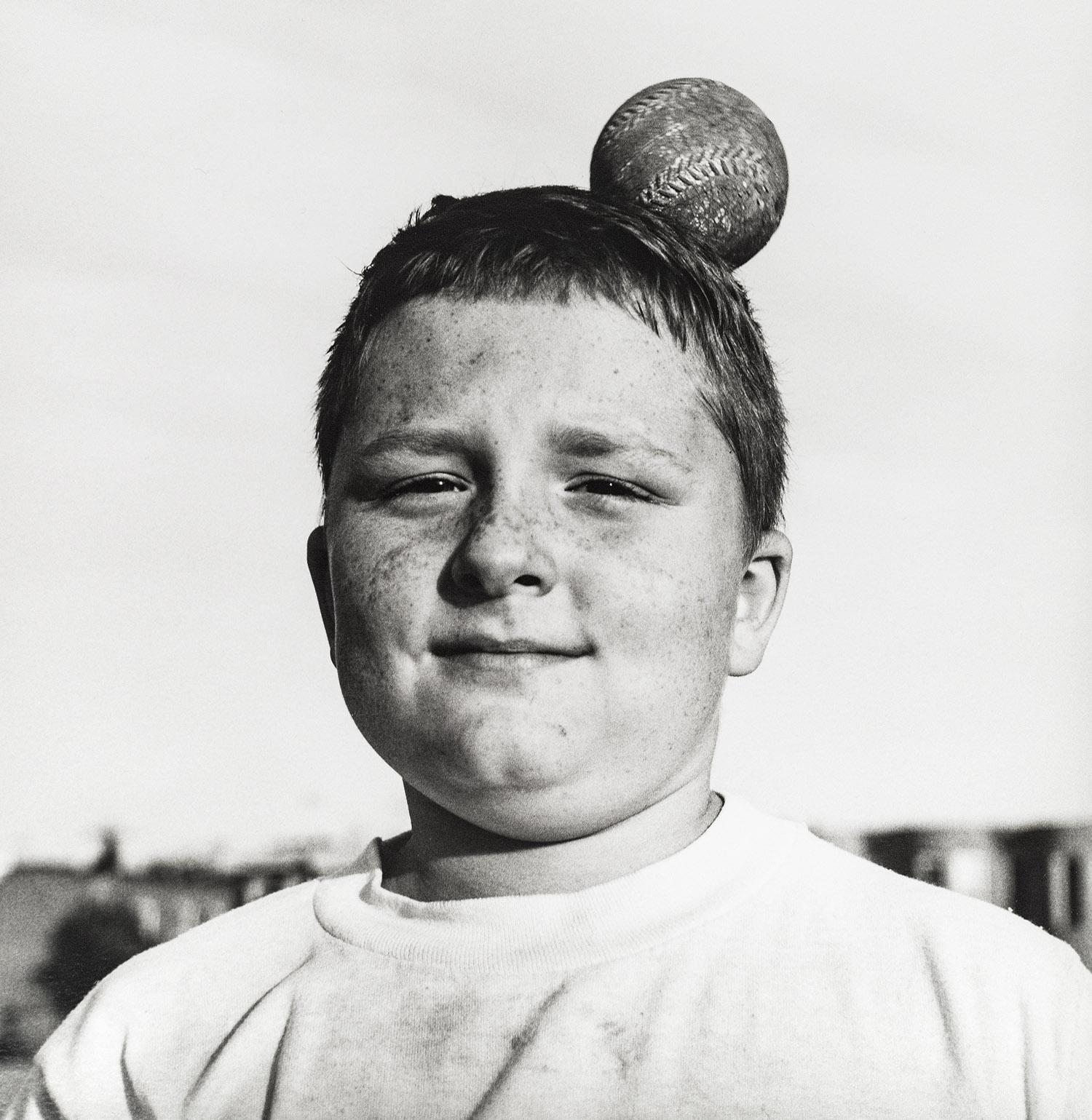 Boy Ball On Head Heading Home.jpg
