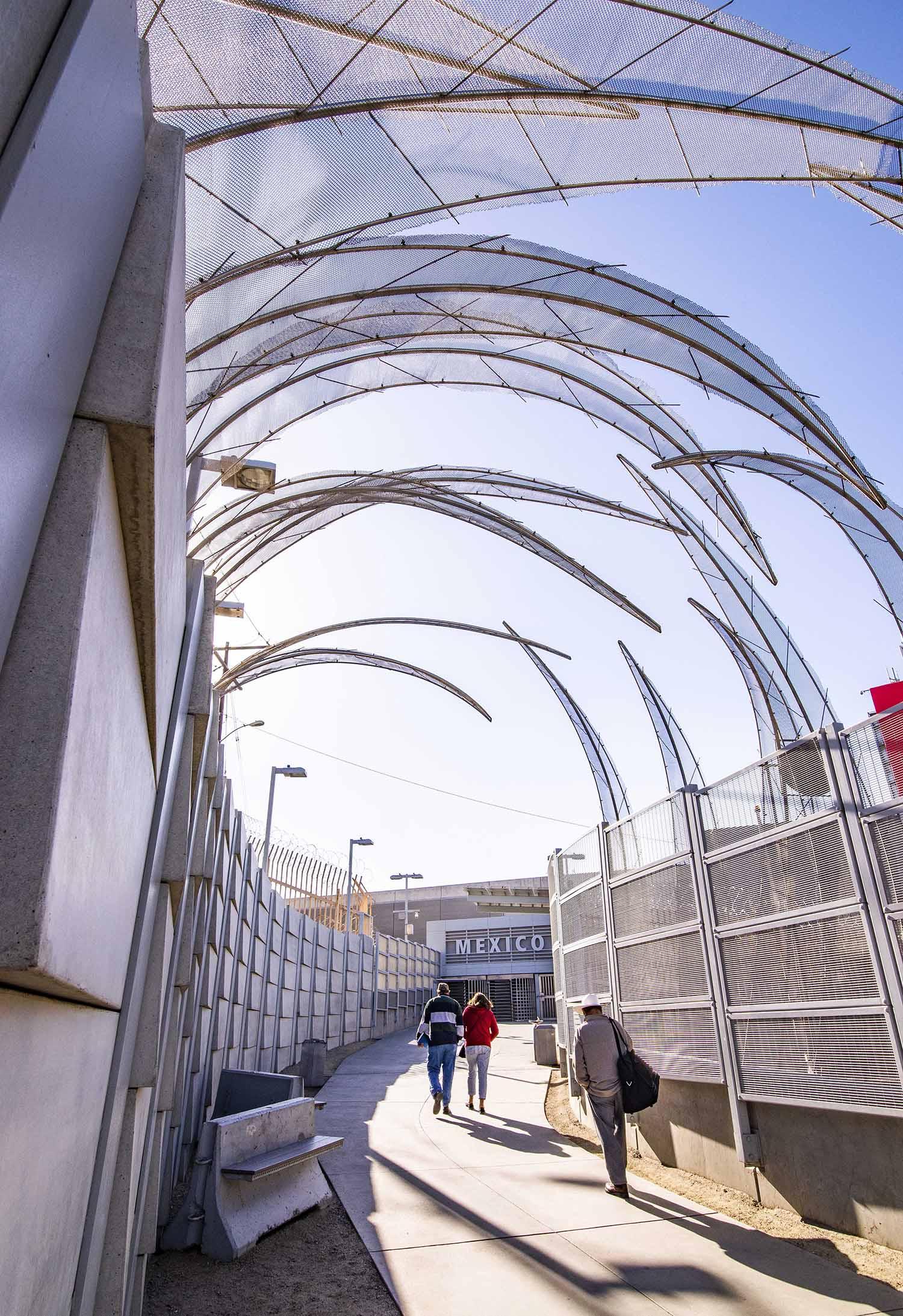 San-Ysidro-border-walls-decorative-barbed-wire-pedestrians.jpg