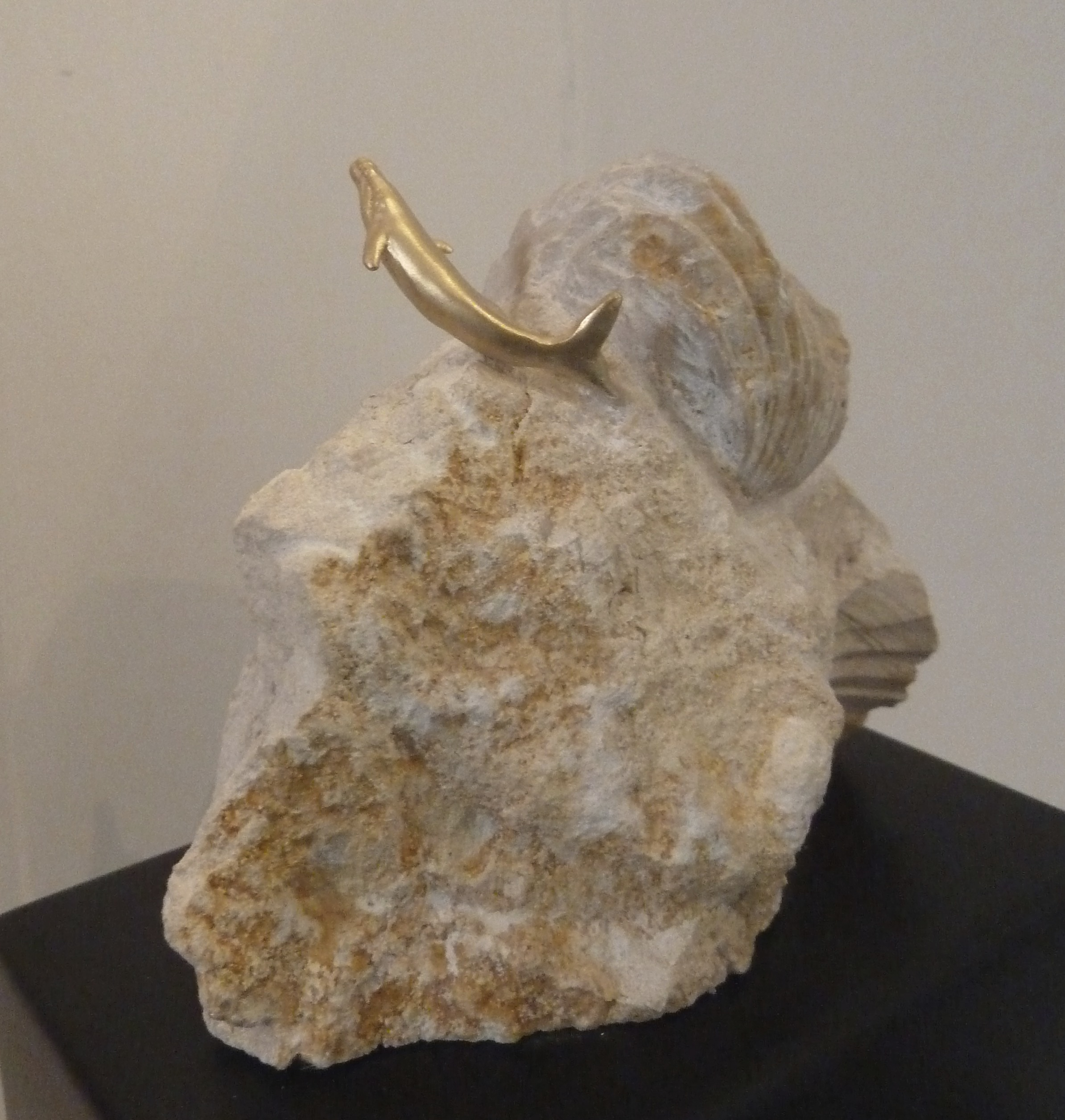 "Poetry in the Sea, 14k, Shell fossil, Belgian marble. 9""x3""x2"". $1,300."