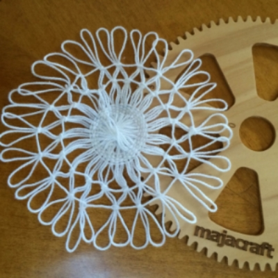 Using the 175mm circular loom, crochet cotton and the Teneriffe Knott, Click on the Image to purchase a circular loom.  www.TheWheelEwe.co.uk