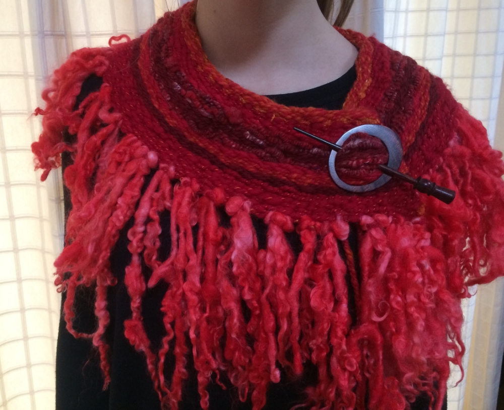 This was made using the large 450mm circular loom. Hand spun and dyed art yarn was used and the fringe was tail-spun yarn hooped on with crochet hook.  www.TheWheelEwe.co.uk