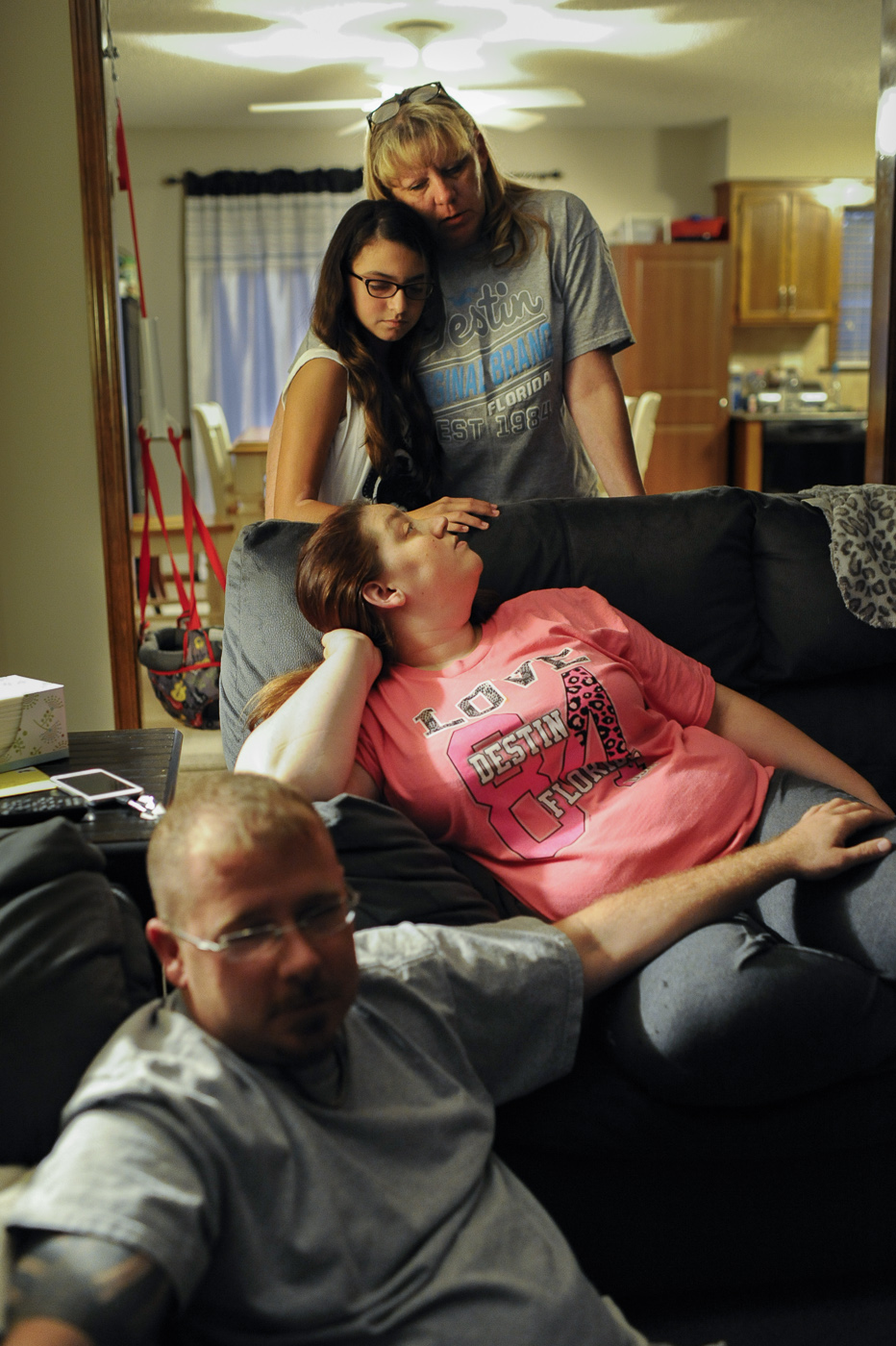 Detective Nancy Penrod shares a moment at home with her daughter Ashley, her boyfriend Heath and 13 year old granddaughter Bailee.