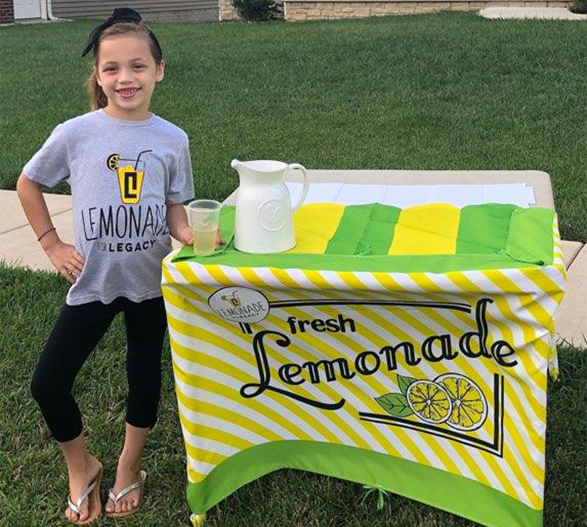 CF Warrior, Harper, proudly posing with her lemonade stand last year!
