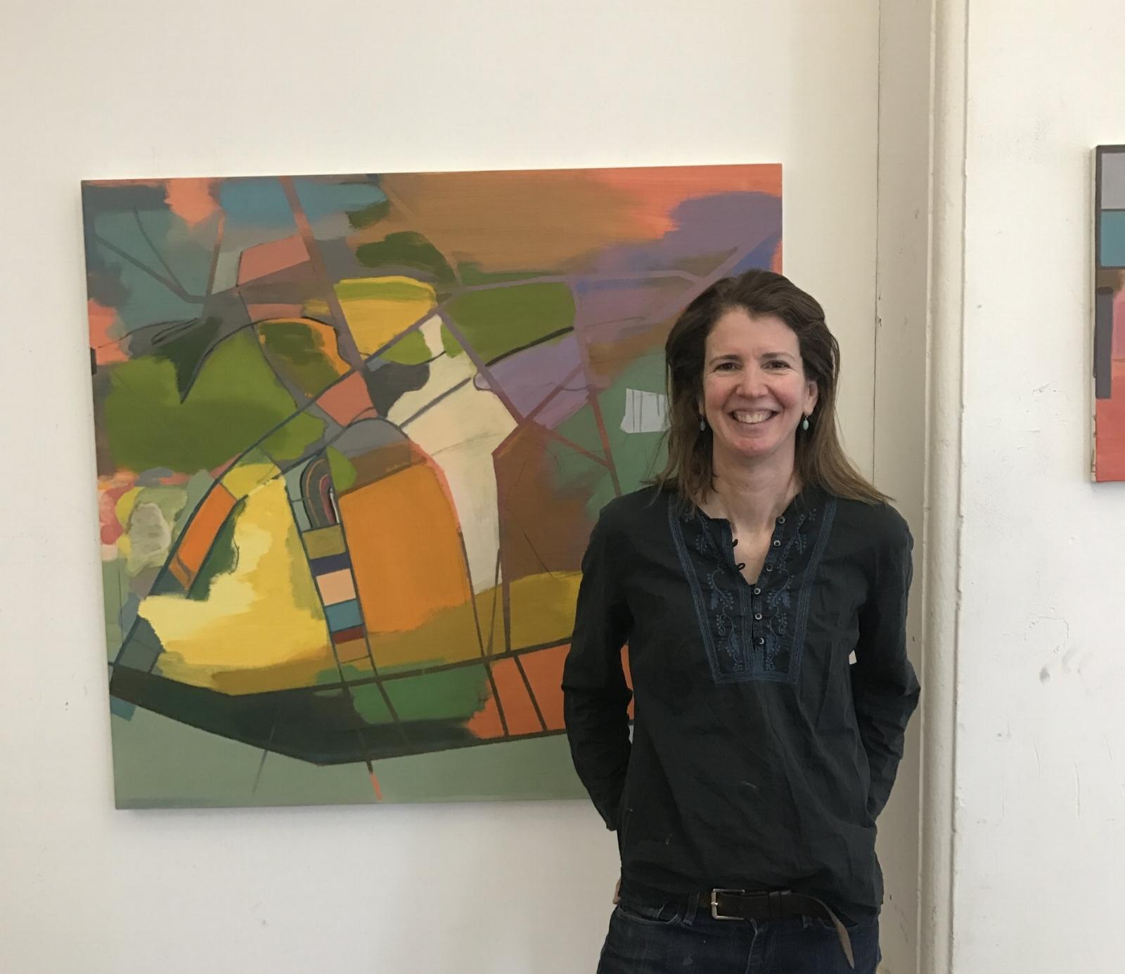 Elizabeth Hazan stands in front of a recent painting of hers in her studio in Brooklyn, New York.