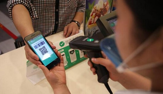 A cashier scanning QR code during a WeChat Pay transaction