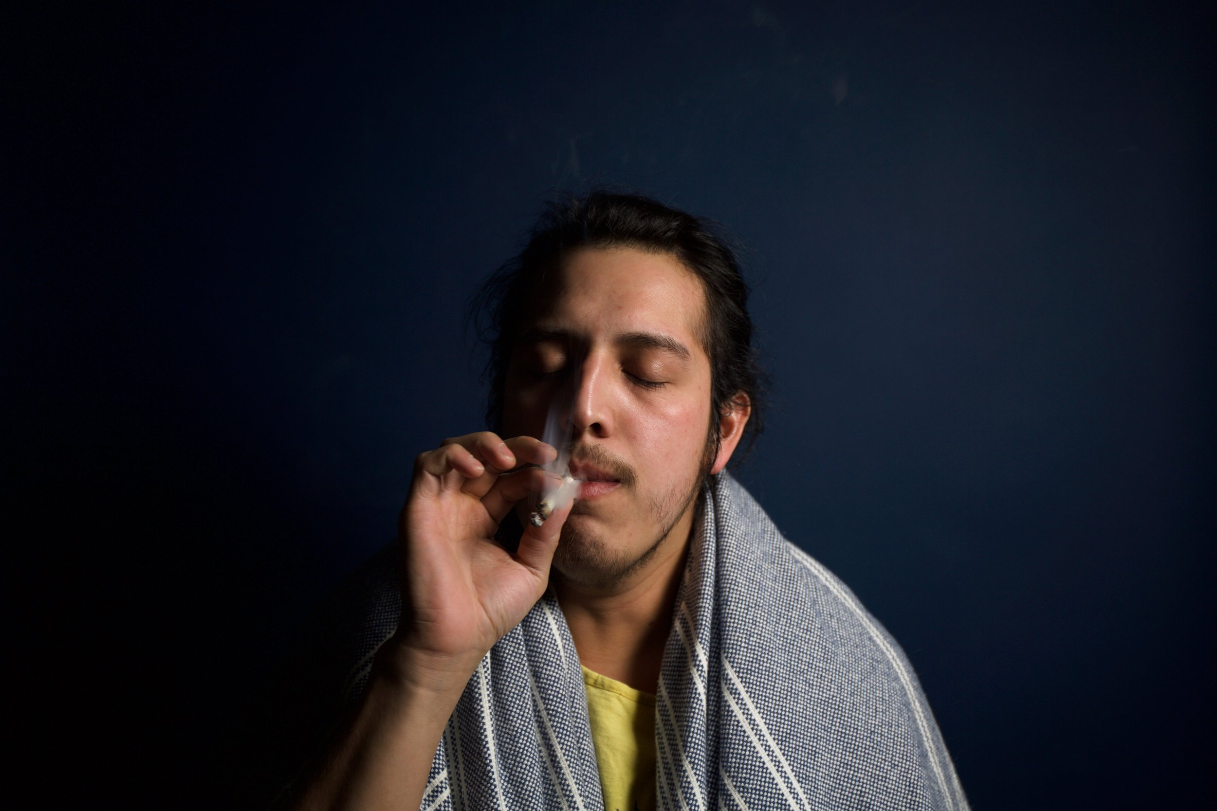 cannabis-cigarette-facial-expression-395087.jpg