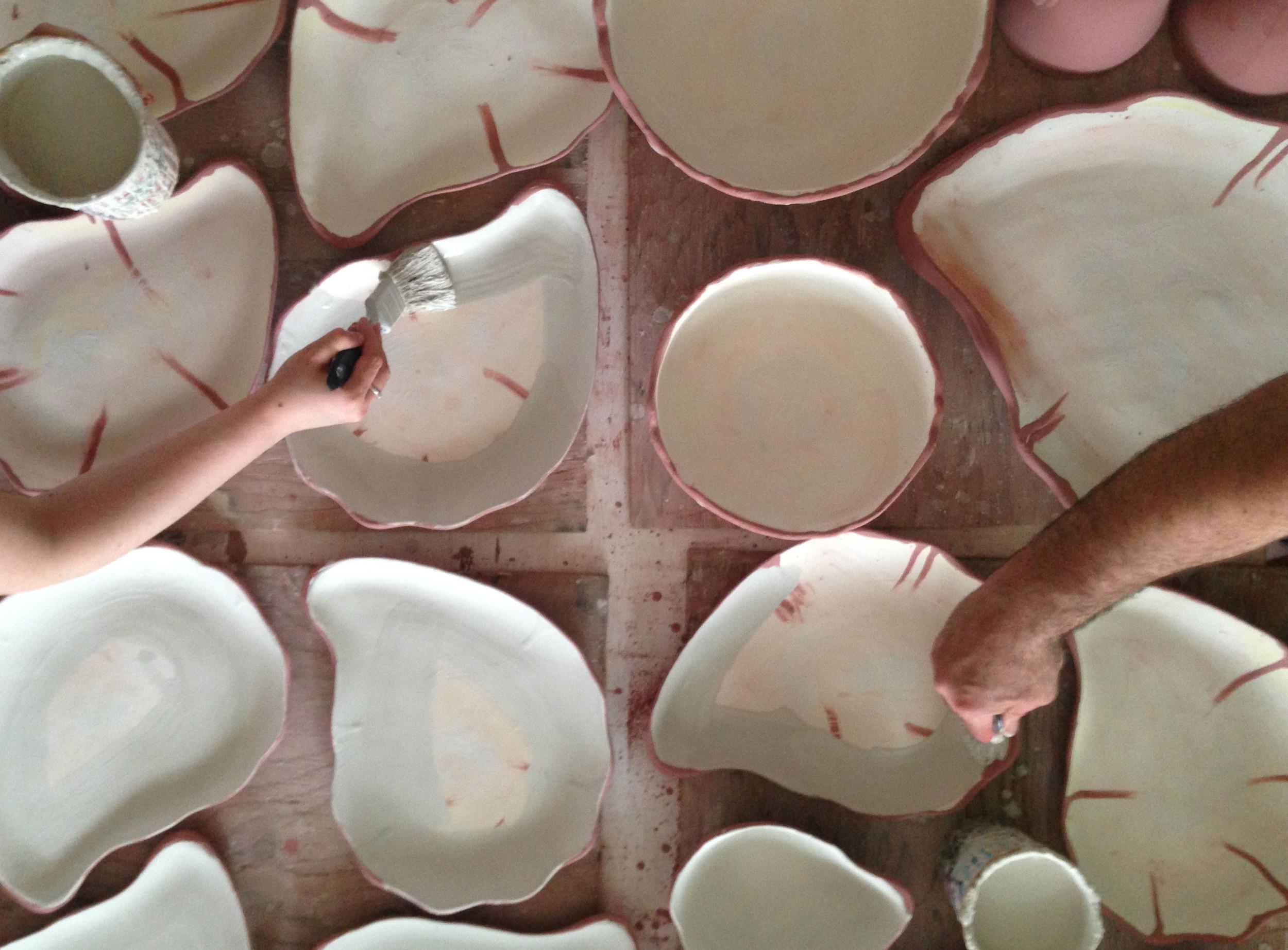 Painting Crystalline glaze on center of plates