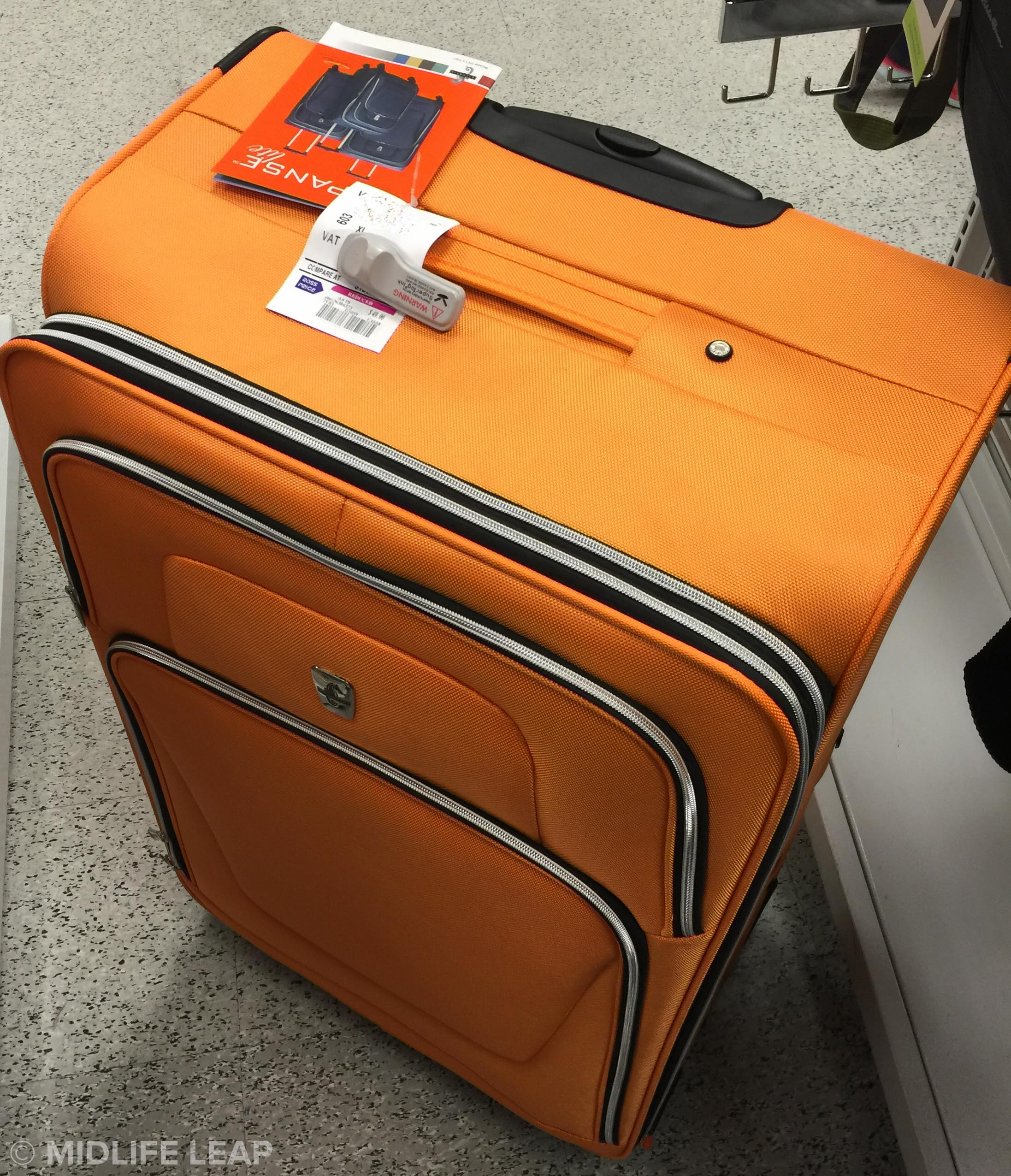 The giant orange suitcase