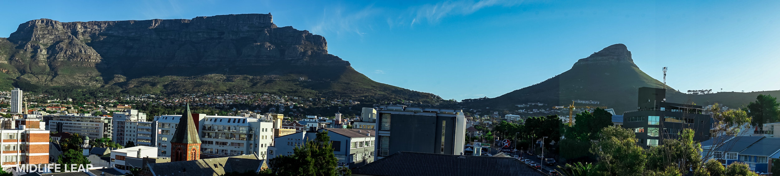 The insane view of Table Mountain (left) and Lion's Head (right) from our second Airbnb in Garden's