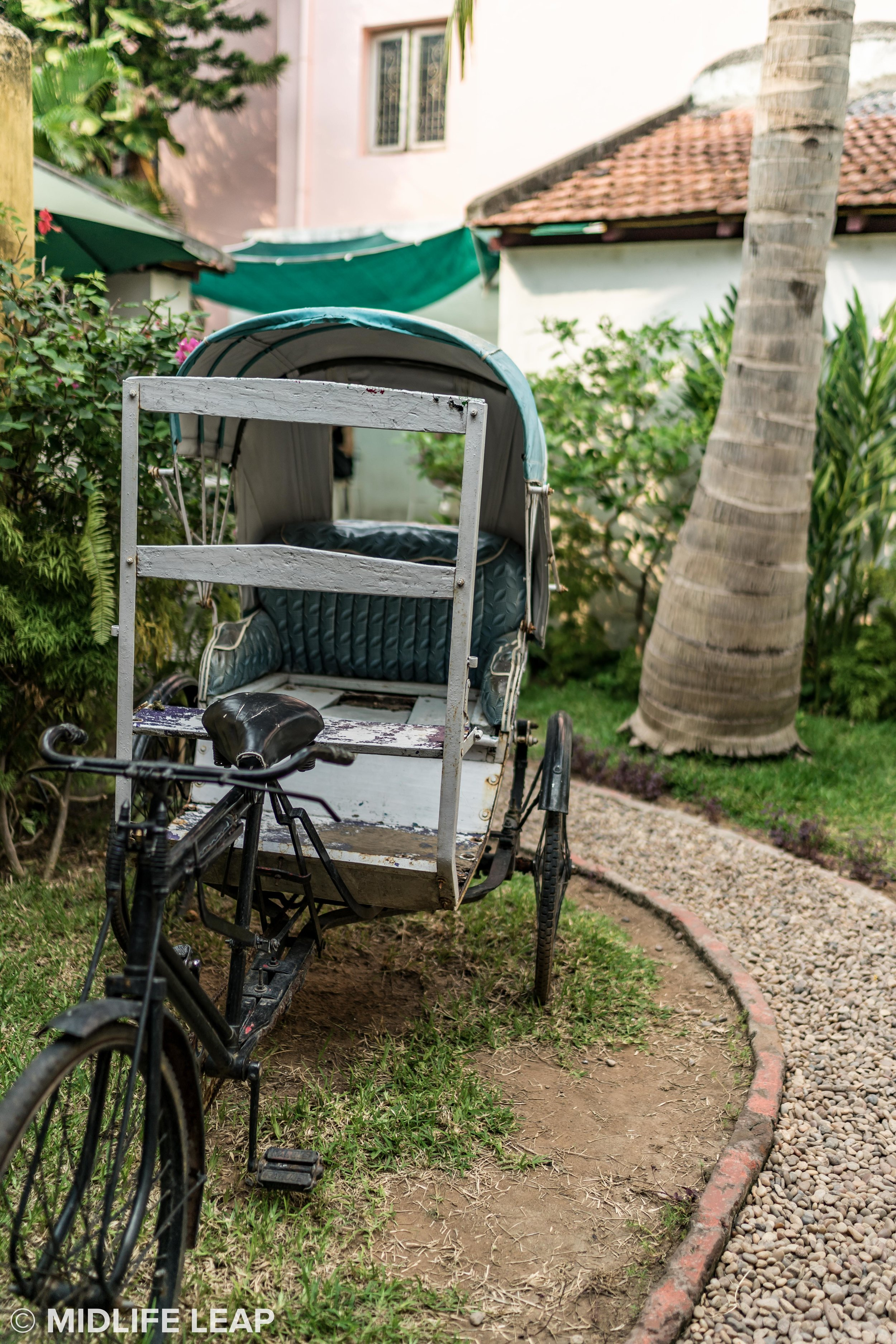 Old rickshaw in the patio