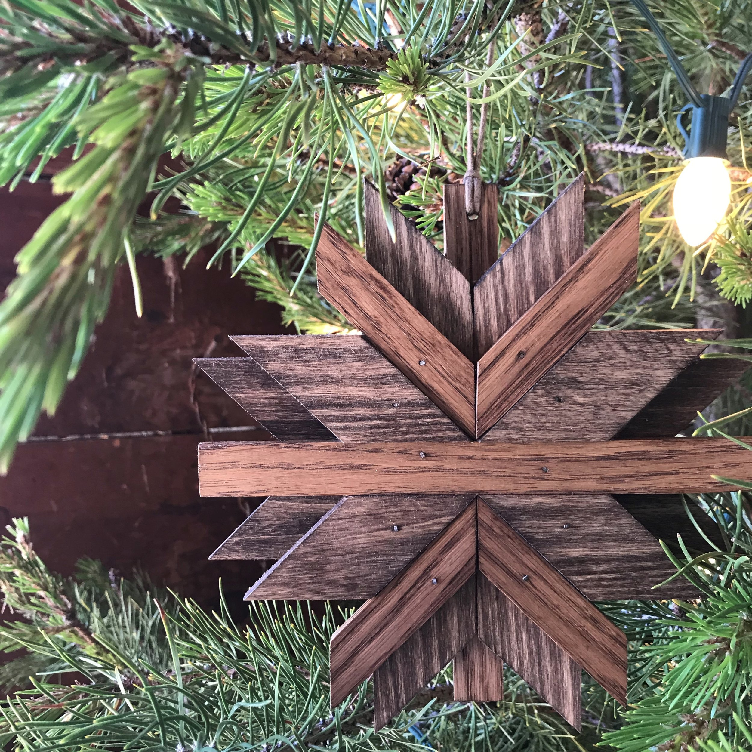 wooden snowflake ornaments on tree 2.jpg