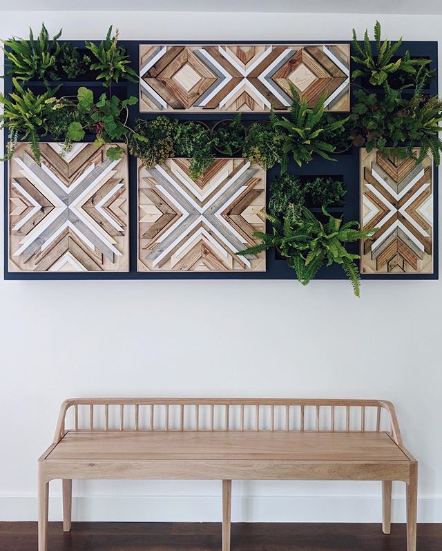 So incredibly excited to see this project come to life! I was recently enlisted for the creative vision of @quartzandbone to create some original woodwork for this entry wall in a client's home. She gave me some measurements + a color palette and let me have fun with what I created, then brought in @floraformdesign to make it into this beautiful plant wall and I am OBSESSED. @plankandgrain crafted the box to house it all, and the moment is made complete by this stunning bench by @ethnicraft . It was such a treat working with @quartzandbone and I hope I'll get to collaborate with her and @floraformdesign more in the future...in fact already feeling like I need this in my home now too. 🌿 Happy Friday, my friends! Xoxo #lauraburkhartcreative . . . . #stayhere #interiorstyling #homedecorinspo #northwestdesign #pnwhome #interiordesigner #seattledesigner #plantwall #woodwallart #seattlehomes #sunsetmagazine #parachutehome #seattlemagazine #geometricart