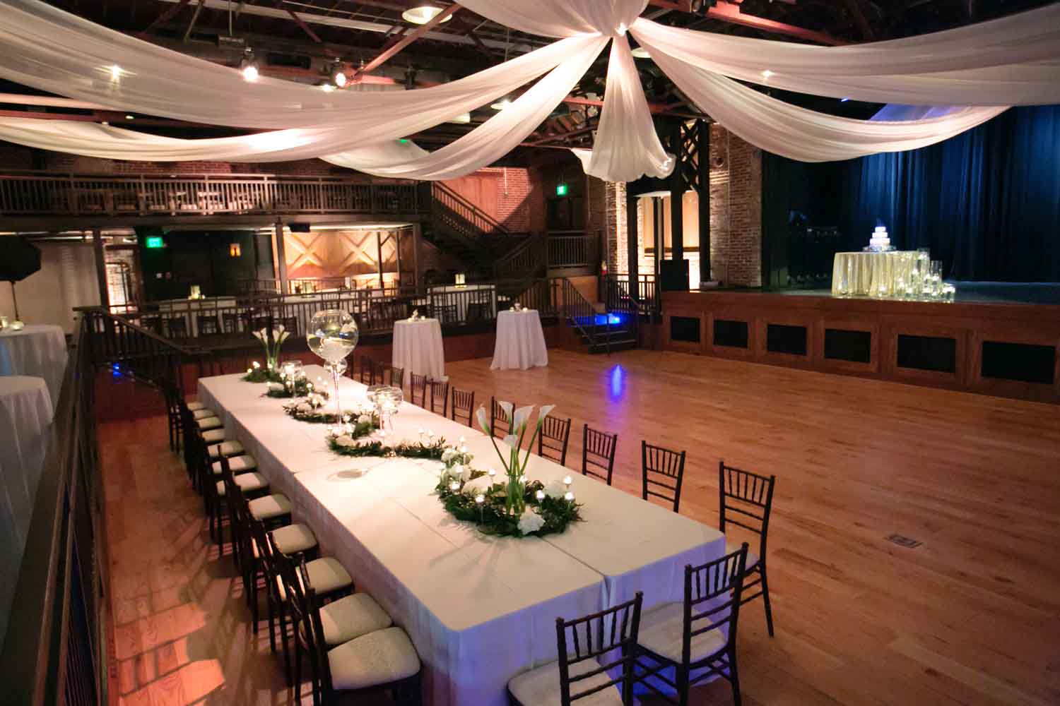 Draping above at Iron City contributed to an organic and breezy atmosphere for Allison and Blake. Photo: Nicole Muro
