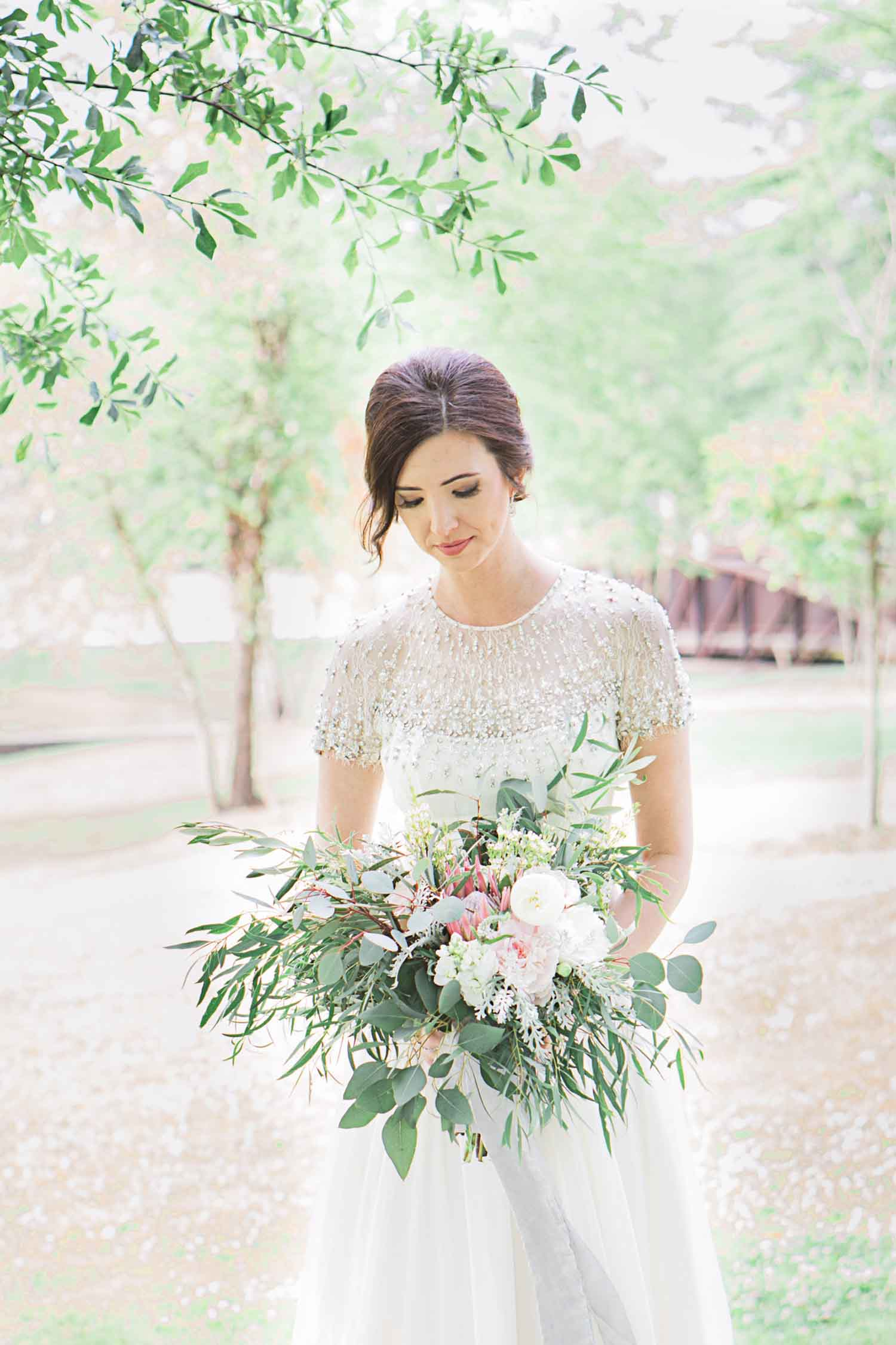 Brittany's bouquet, styled by Suzanne Martensen at Stems and Styles, includes greenery and an asymmetrical look emblematic of the growing trend toward organic and natural at weddings. Photo:  Angela Karen