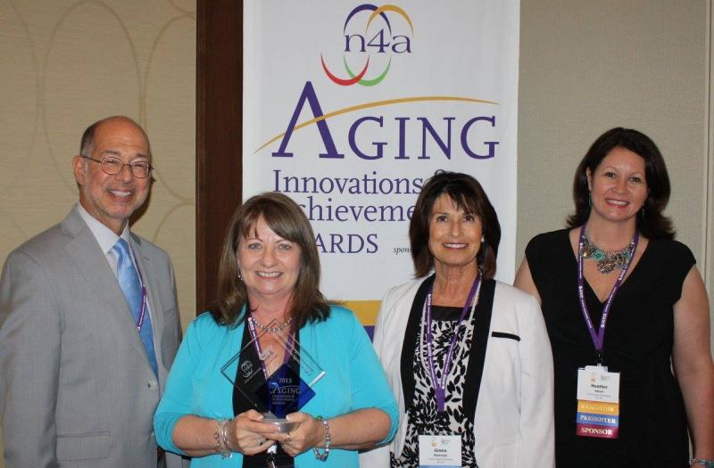 BRENDA REECE, HIGH COUNTRY CAREGIVER FOUNDATION DIRECTOR, RECEIVING ONE OF THE AGING INNOVATIONS AWARD FROM THE NATIONAL ASSOCIATION FOR AREA AGENCIES ON AGING IN 2015.