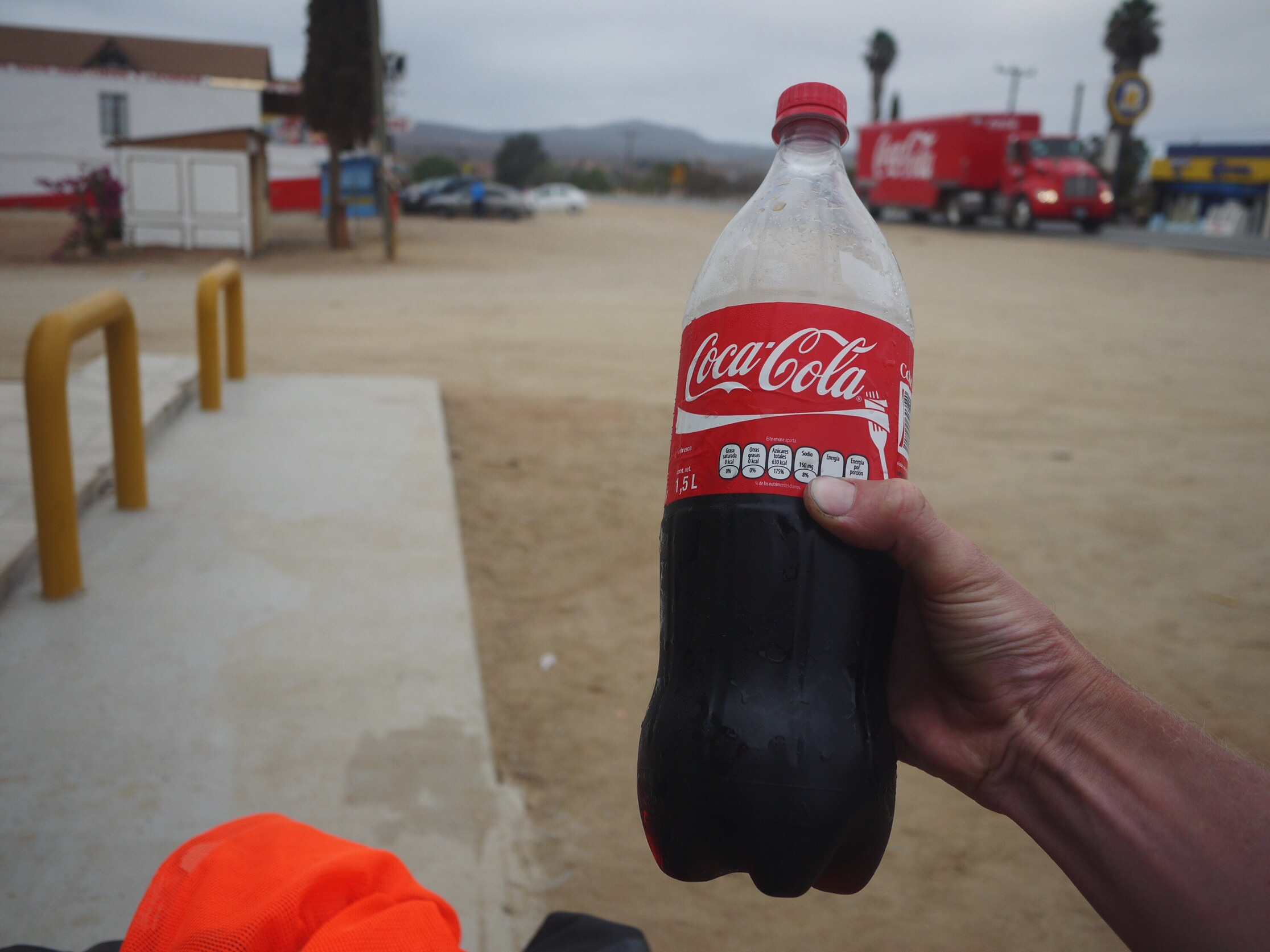 Moments before this moment, the Coca Cola truck in the background passed another semi taking up both of the oncoming lanes and leaving us pulling cactus thorns in the ditch. We both swore oaths to never touch the stuff again the rest of the way into town. Sun blasted and staring off into space outside the mercado a local man stuffed a 1.5 liter (!!) bottle into my hand, ignoring my protests as he gestured to his own 1.5 liter. Oath broken, near tears at his generosity and left to sift through the levels of irony for the remainder of the evening's ride.