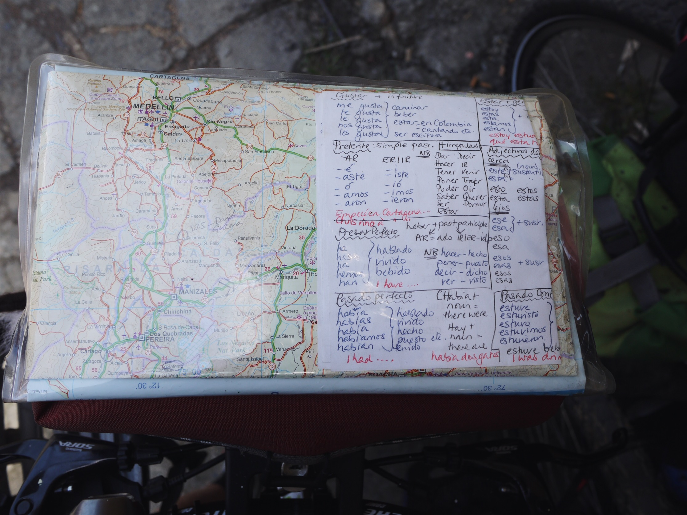 Fellow bike traveler Kate staring down at the navigational bare essentials: roads and verbs.
