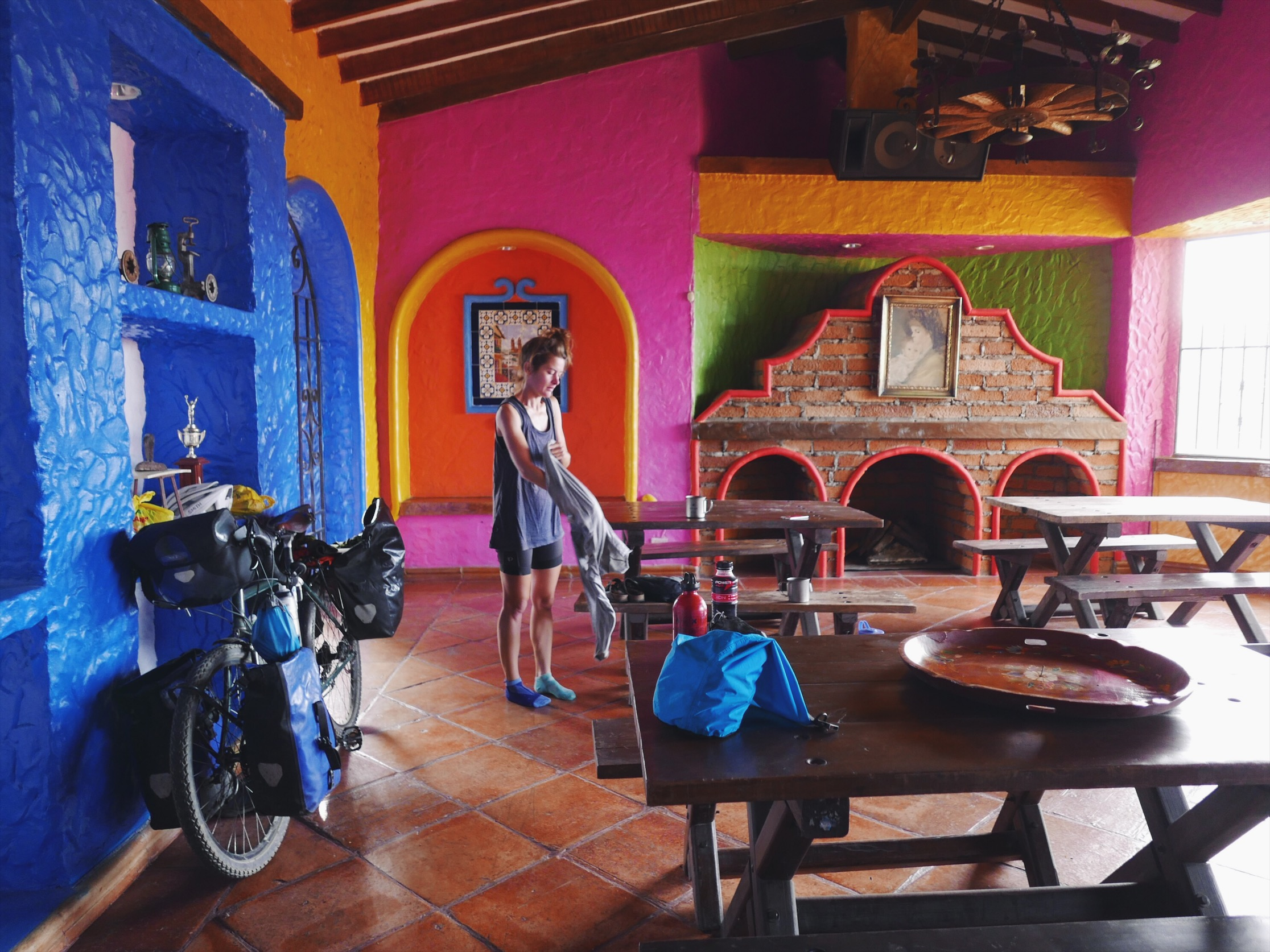 Roadside and completely wrecked, a generous Colombian family offered us space in this long-since-closed restaurant. Easily one of our most colorful campsites.