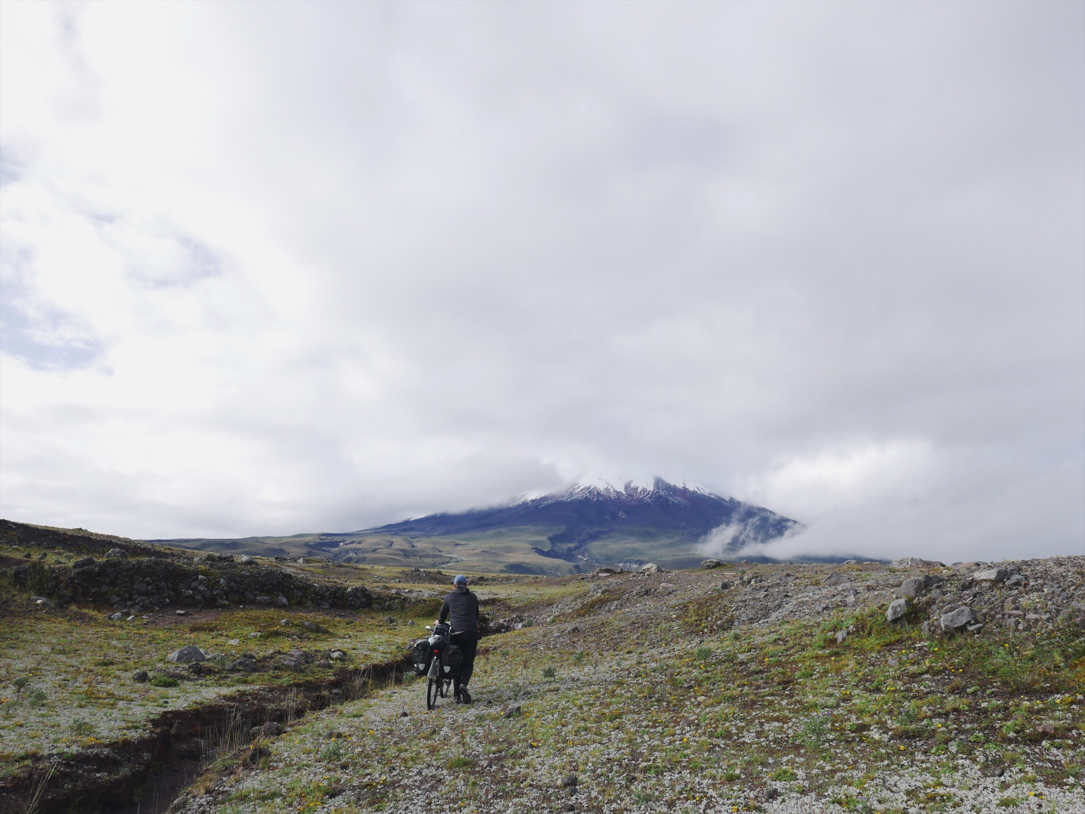 Tundra, erosion paths and eruption blasted boulders. Cotopaxi is otherworldly cool.