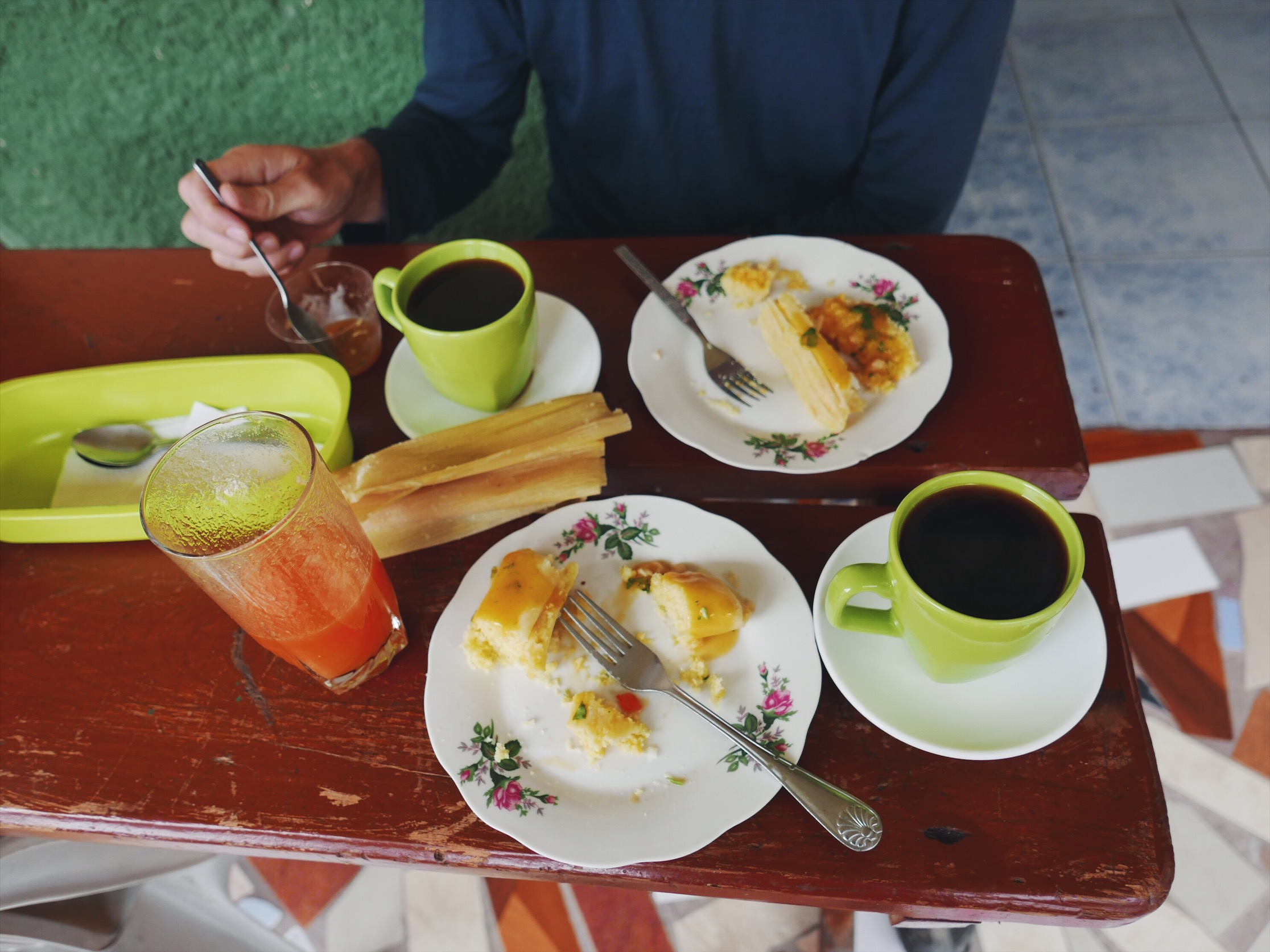 Mid-morning snack. Humitas are a tamale-like dream made from fresh corn and lard, typically served with a bowl of fresh ají—homemade hot sauce.