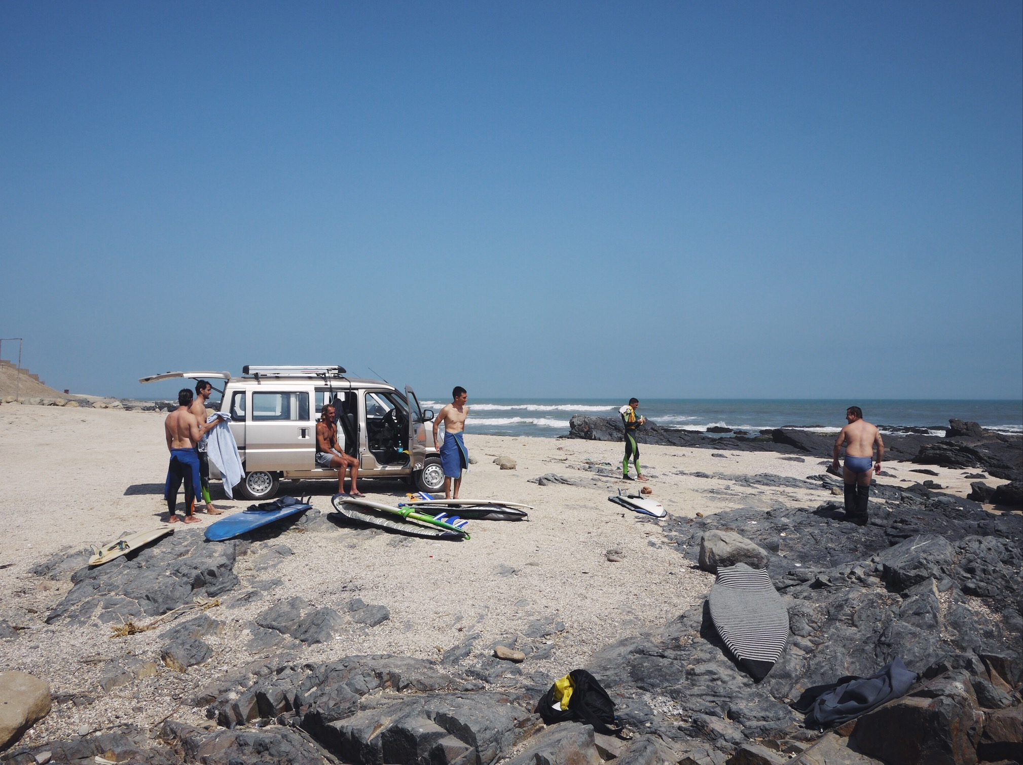 Van rides down the road to better surf. Back in wetsuit waters.