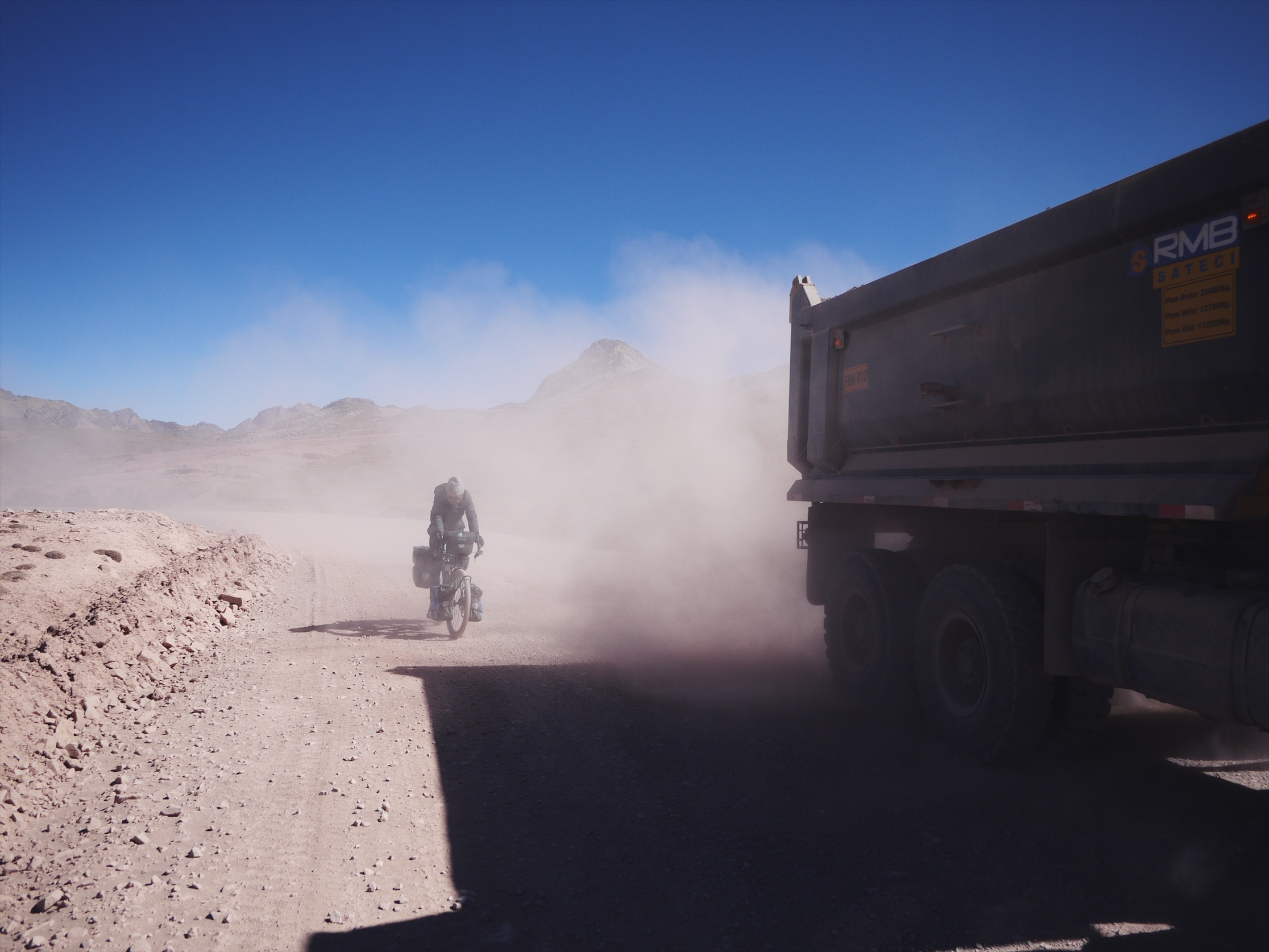 Roads are built for a purpose. Often, on the more remote roads, that purpose is to extract the resources that lie at their distant ends. When you dump-truck drive the same 20 miles for a lifetime, you think little of dusting lost gringos.