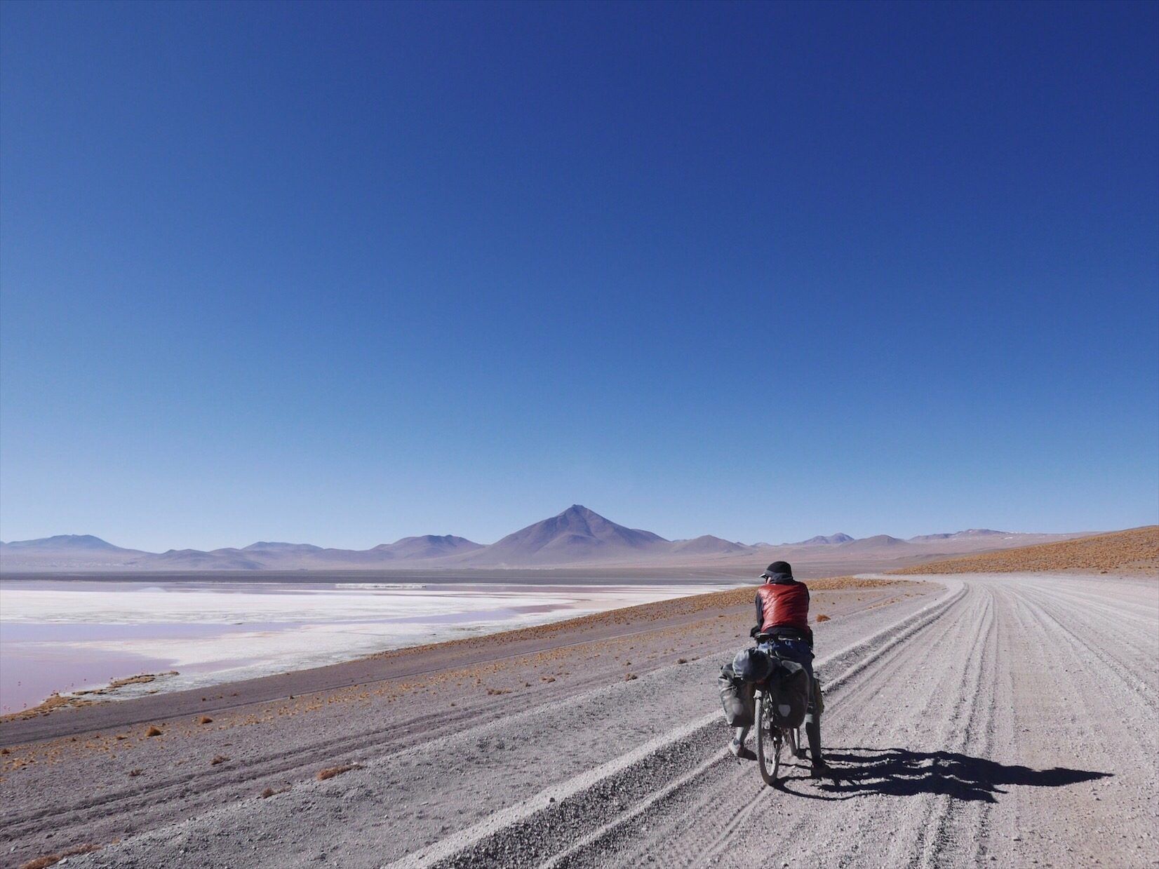 The Lagunas Route through Southwest Bolivia is famous/infamous among cyclists for its beauty and challenging roads. Looking out across a blood red lake filled with pink flamingos and icebergs is almost worth spending eight days pushing through half a foot of kitty litter.