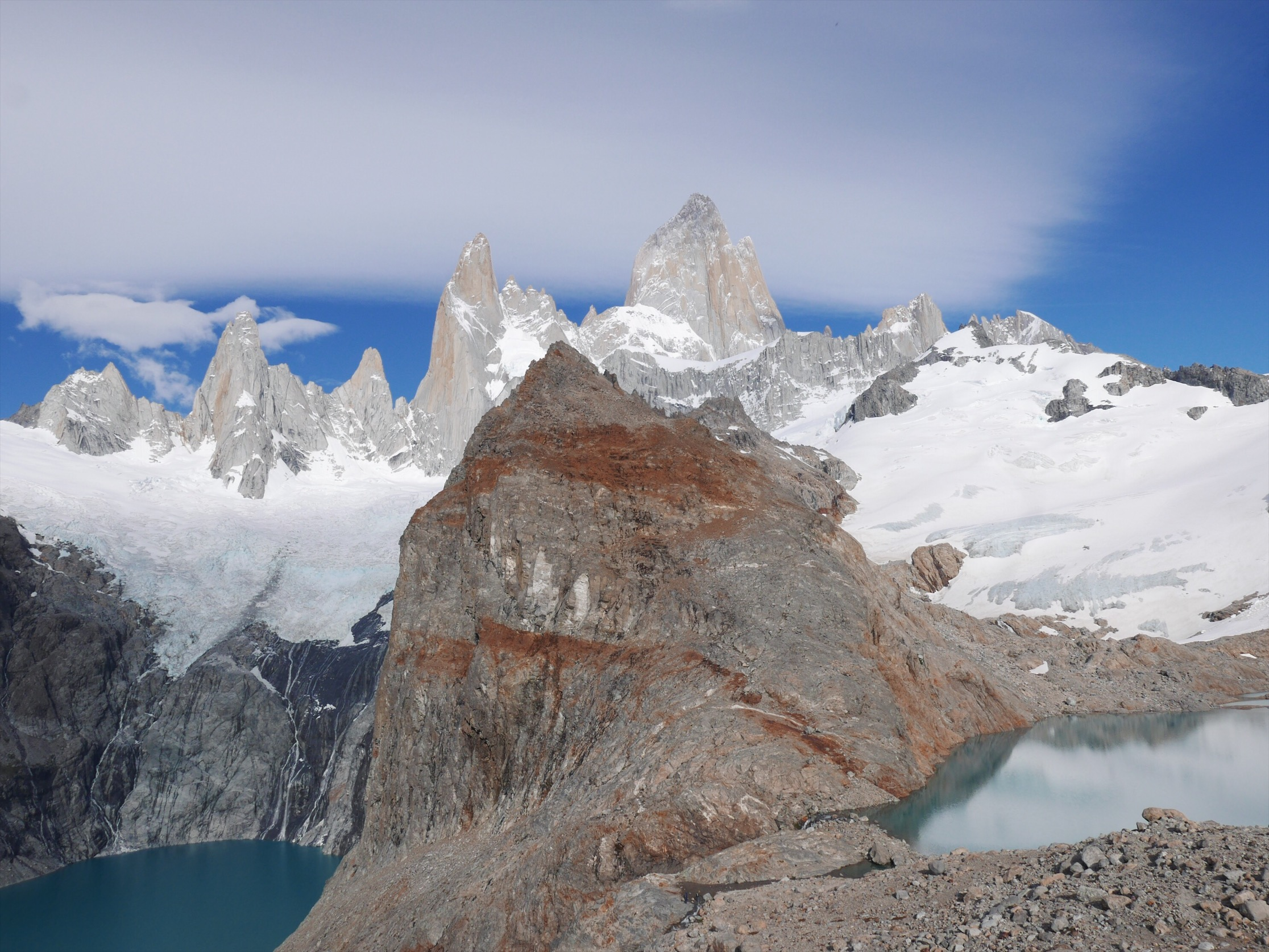 Neighboring lagunas foreground for the seven peaks comprising the Fitz Roy skyline. Fitz's 5,000-foot granite fin is an impressive sight to behold. We later watched the film  A Line Across the Sky  documenting climbers Tommy Caldwell and Alex Honnold's quest to traverse all seven peaks in a single expedition—a feat that only seems more absurd having sat underneath them.