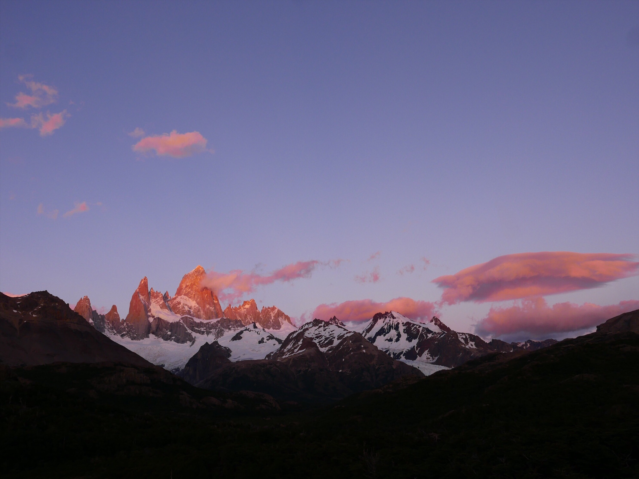 A 3:45AM wake up had us cresting the last ridge just as the very top of Fitz Roy illuminated. The sunrise gradient grew—from the tip down—eventually painting the entire horizon. Much like other hike excursions on this trip, we ended up in the right place, at the right moment, without planning anything beyond T-bone's early call time.
