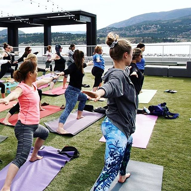 Happy International Yoga Day! I'm no expert yogi but I do enjoy learning and growing each practice. 🧘‍♀️ This photo makes it look like we're right at the lake but actually we're about 7 stories up on the roof of the Innovation Centre in Kelowna! 🙌 Thanks @solstice.yoga @cityyogaxkelowna for a great flow.  PC: @erycastirling
