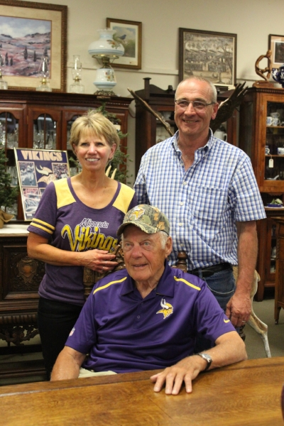 Mr. Bud Grant with store owners Jeff and Lynelle Lanoue.