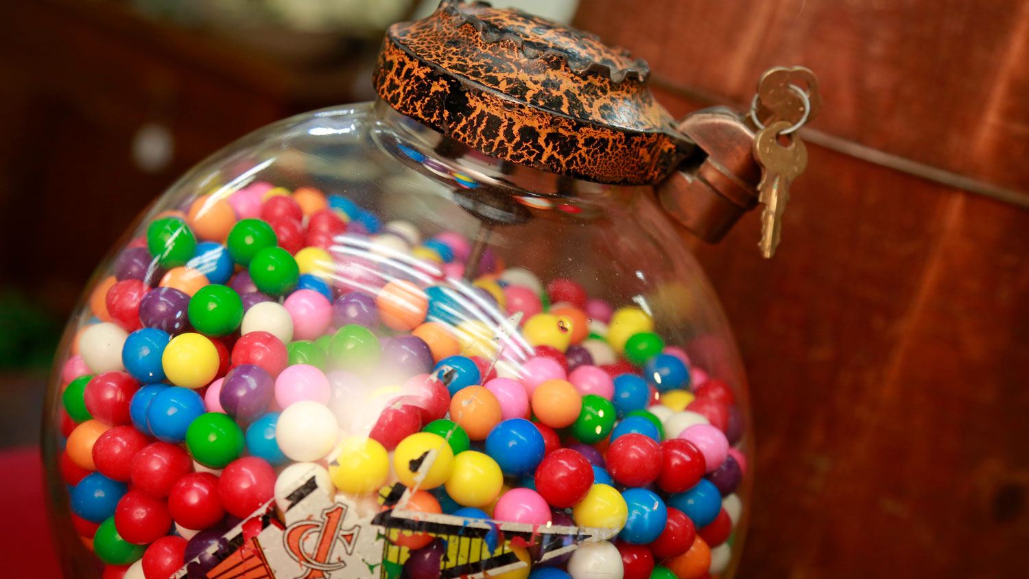 The unique castle top and crackle finish of this gumball dispenser is shown.