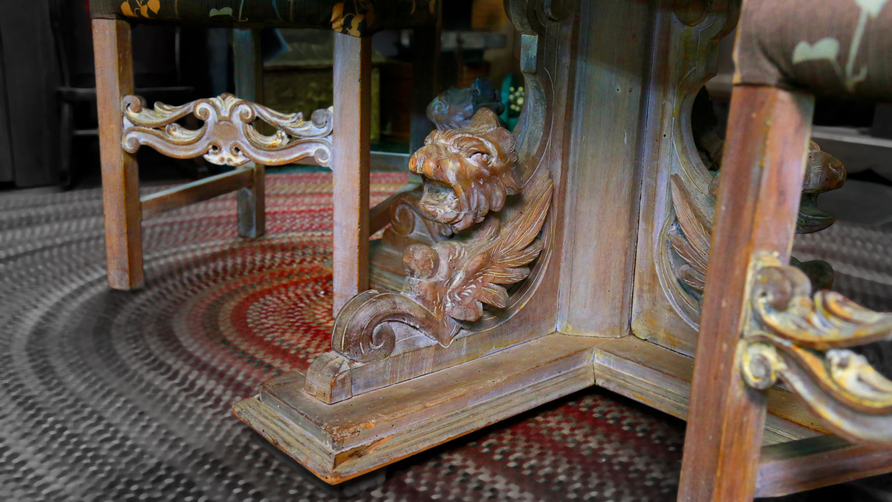Intricate carved legs on dining table