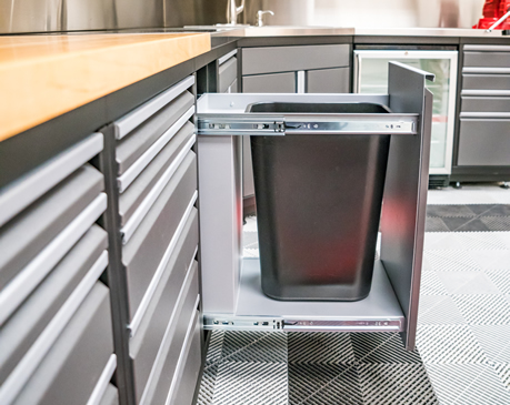 TRASH BIN CABINET-  No one wants trash laying around these custom cabinets. We offer a beautiful, inline trash can cabinet option.