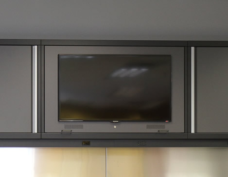 TELEVISION CABINET - If you spend a lot of time in your garage, it will be important to not miss the big game. We offer flatscreen TV cabinets.