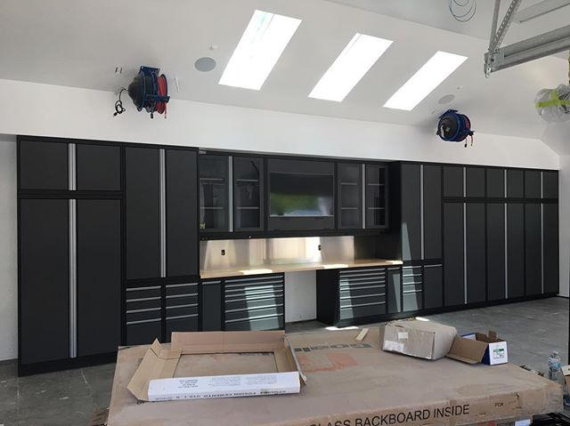 Just this week we had a install in California. I love this clients choice to frame the TV with glass door cabinets. . . . . . . #car #cars #garage #robbreport #garages #racecar #madeintheusa #houzz #porsche #porscheclub  #amazingcars247 #hgmotorsports #menwithautos #automotiveexperience #caranddrivermag #autocars1