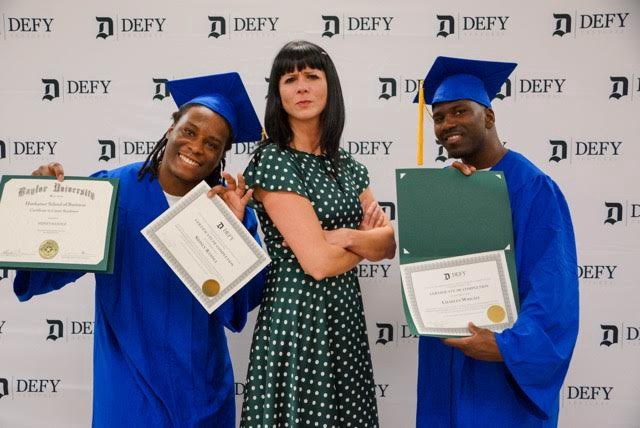 Cat Hoke, founder of Defy Ventures with some of the graduates from the program