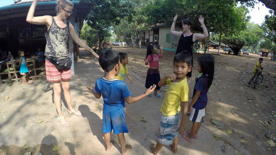 teachers and kids playing games