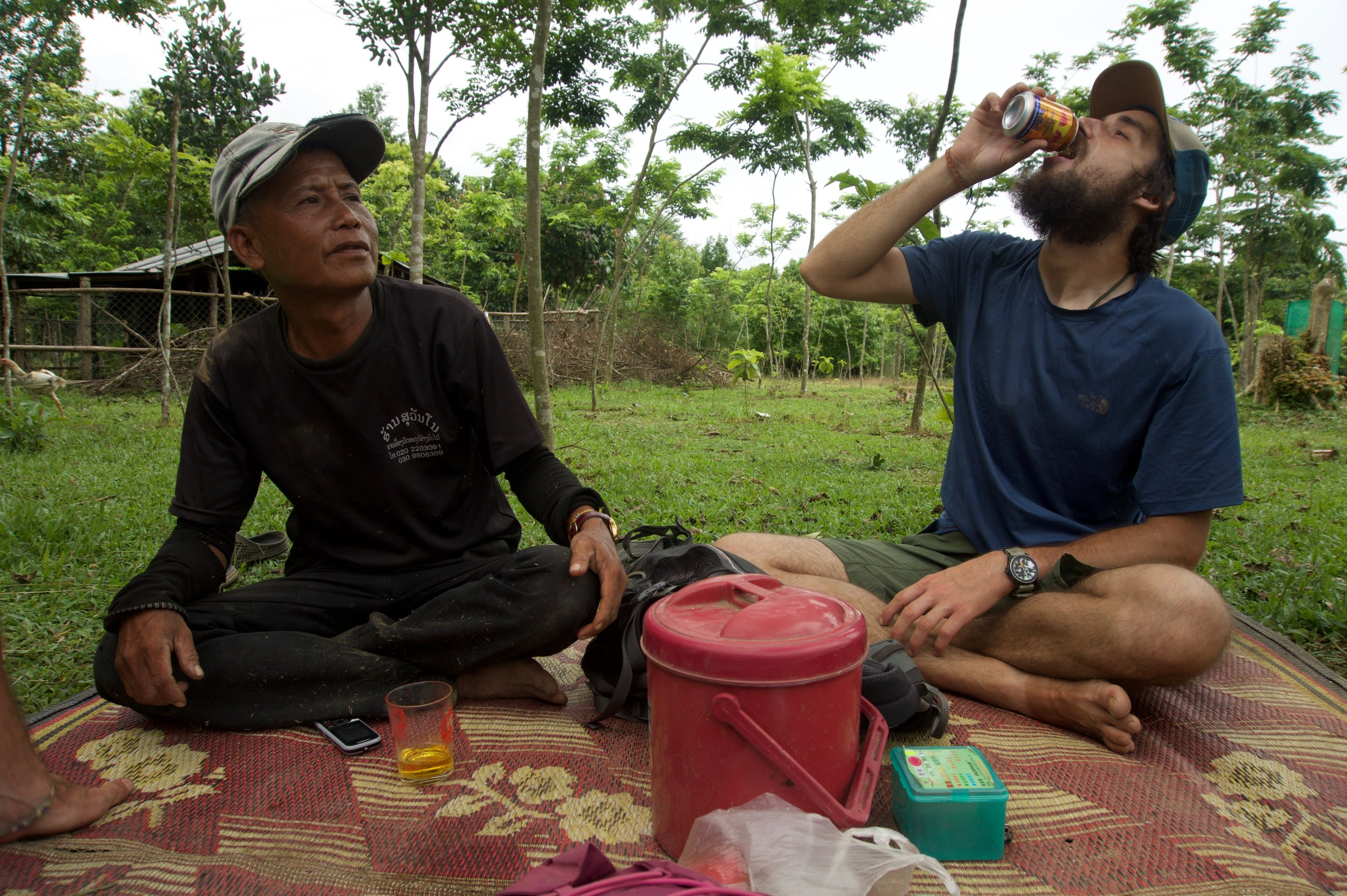 Afternoon picnic in the garden with Captain (Native Laotian) and Sebastian (guest at the guesthouse I was volunteering at). Kasi, Laos