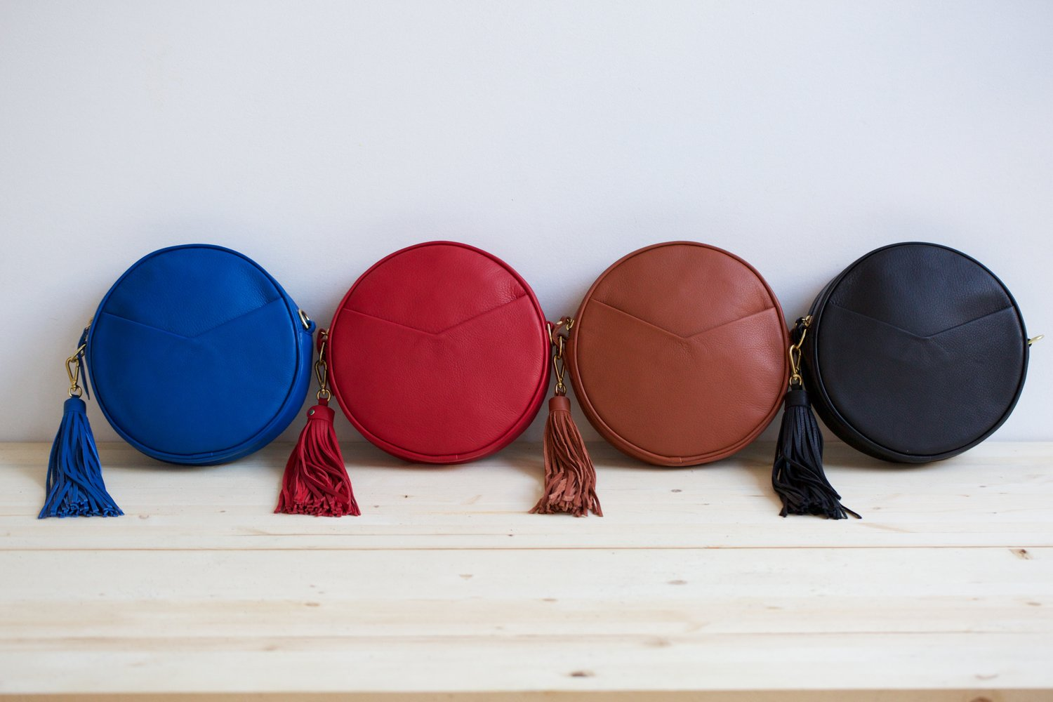 The Circle Bag is currently available in four colors - bold blue, pure red, cognac, and black.