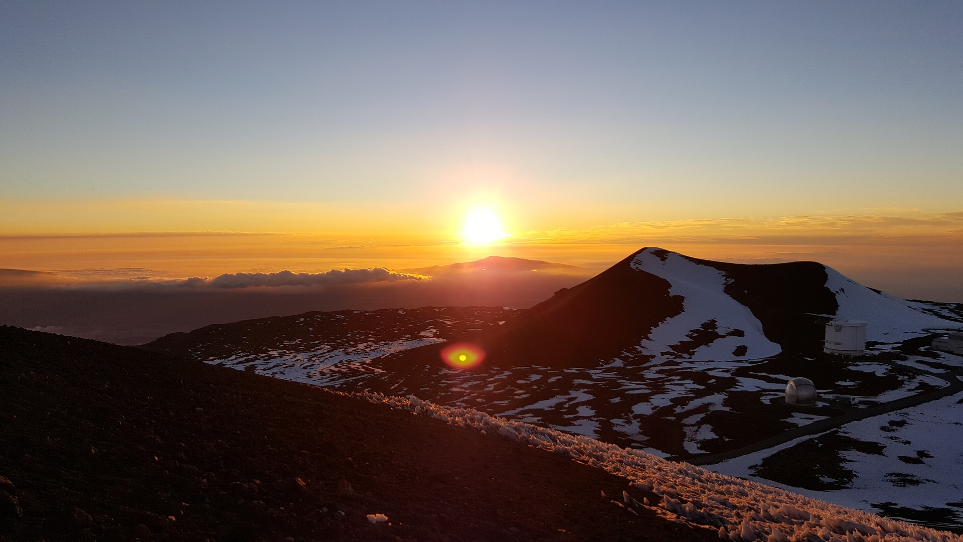 View of the sunset from the top of Mauna Kea, where the lava glow can be seen at night.