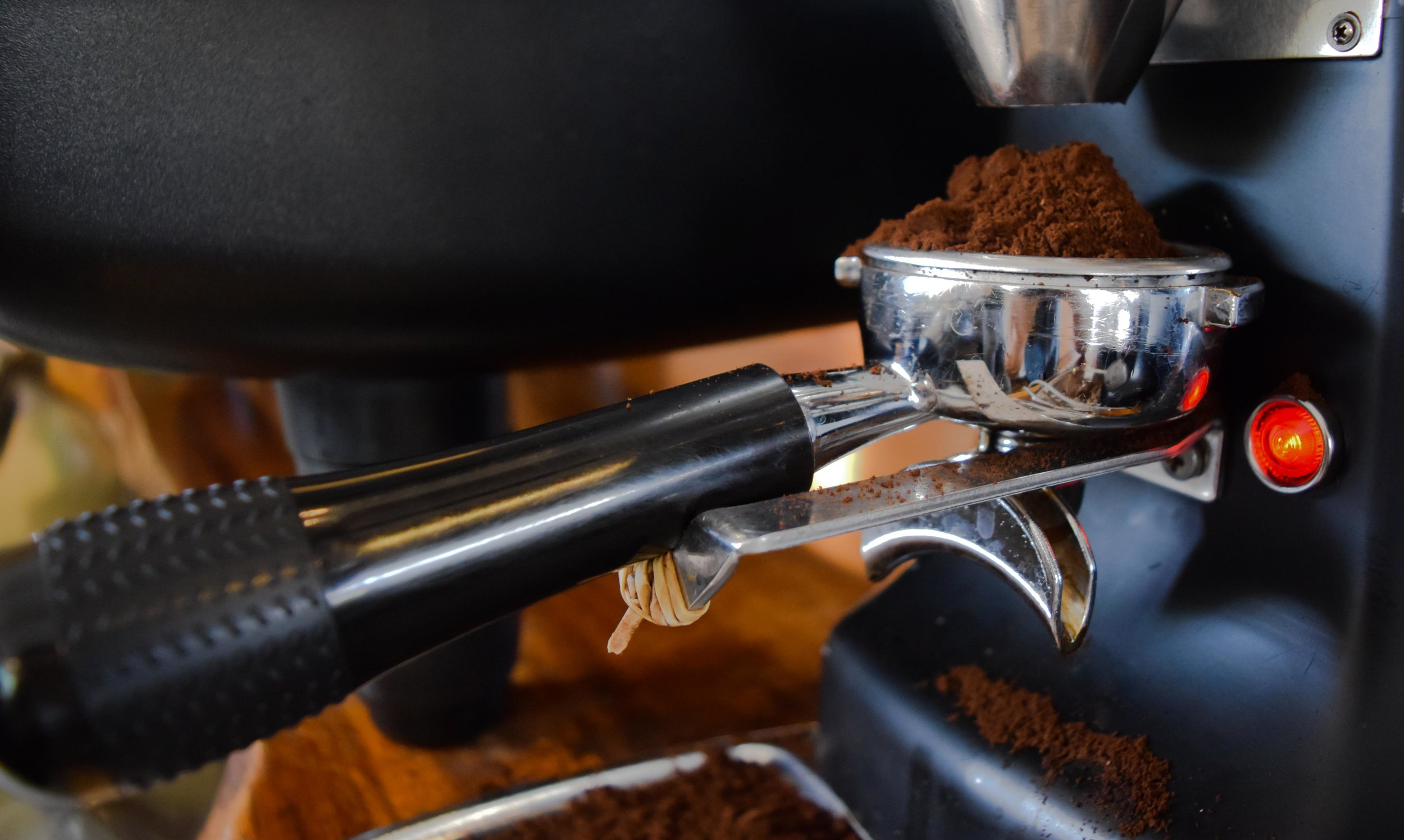Finely ground coffee about to become espresso at our Kailua-Kona café. PHOTO: Dayva Keolanui