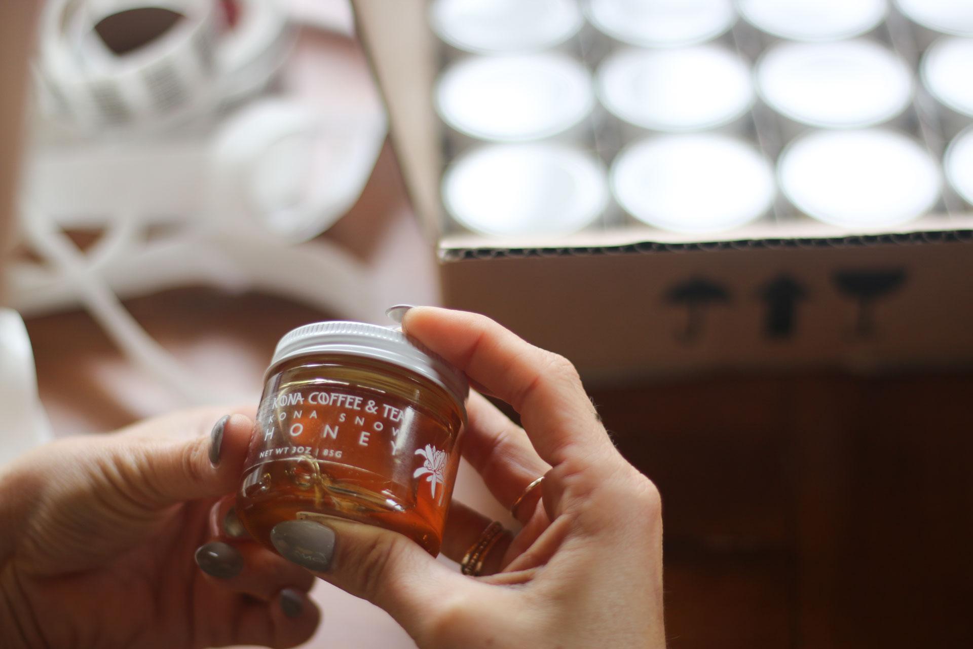 Holding Kona Snow Honey.jpg