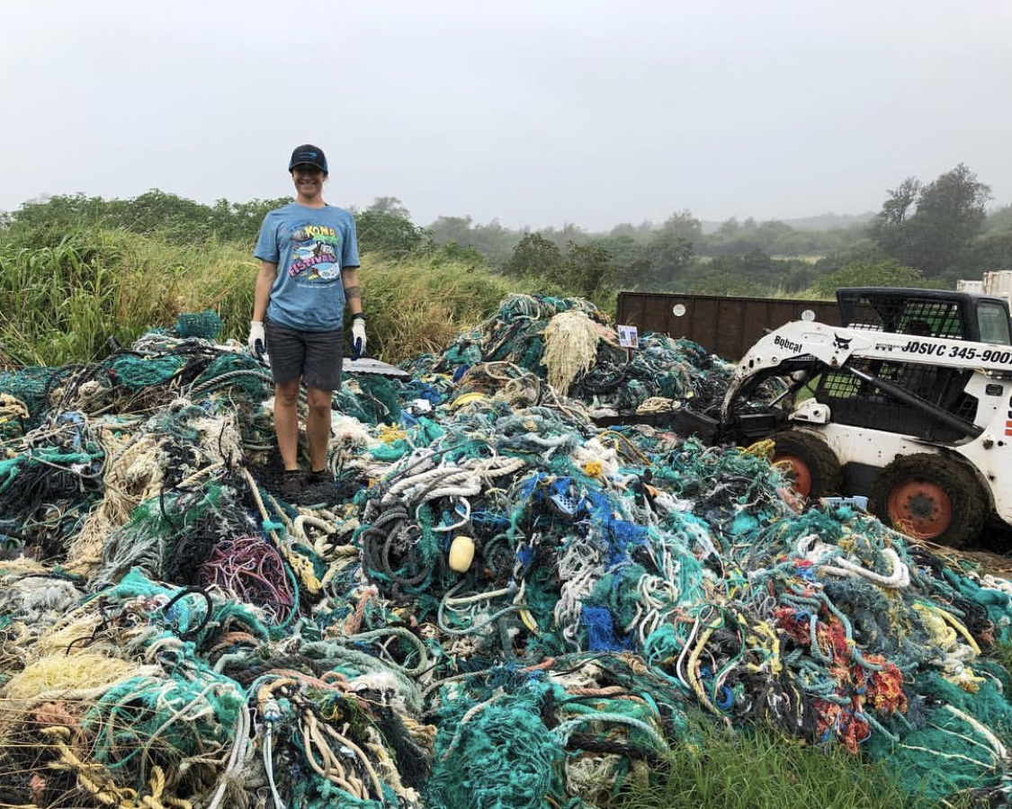 Megan Lamson with Hawai'i Wildlife Fund hauling out thousands of pounds of ghost nets