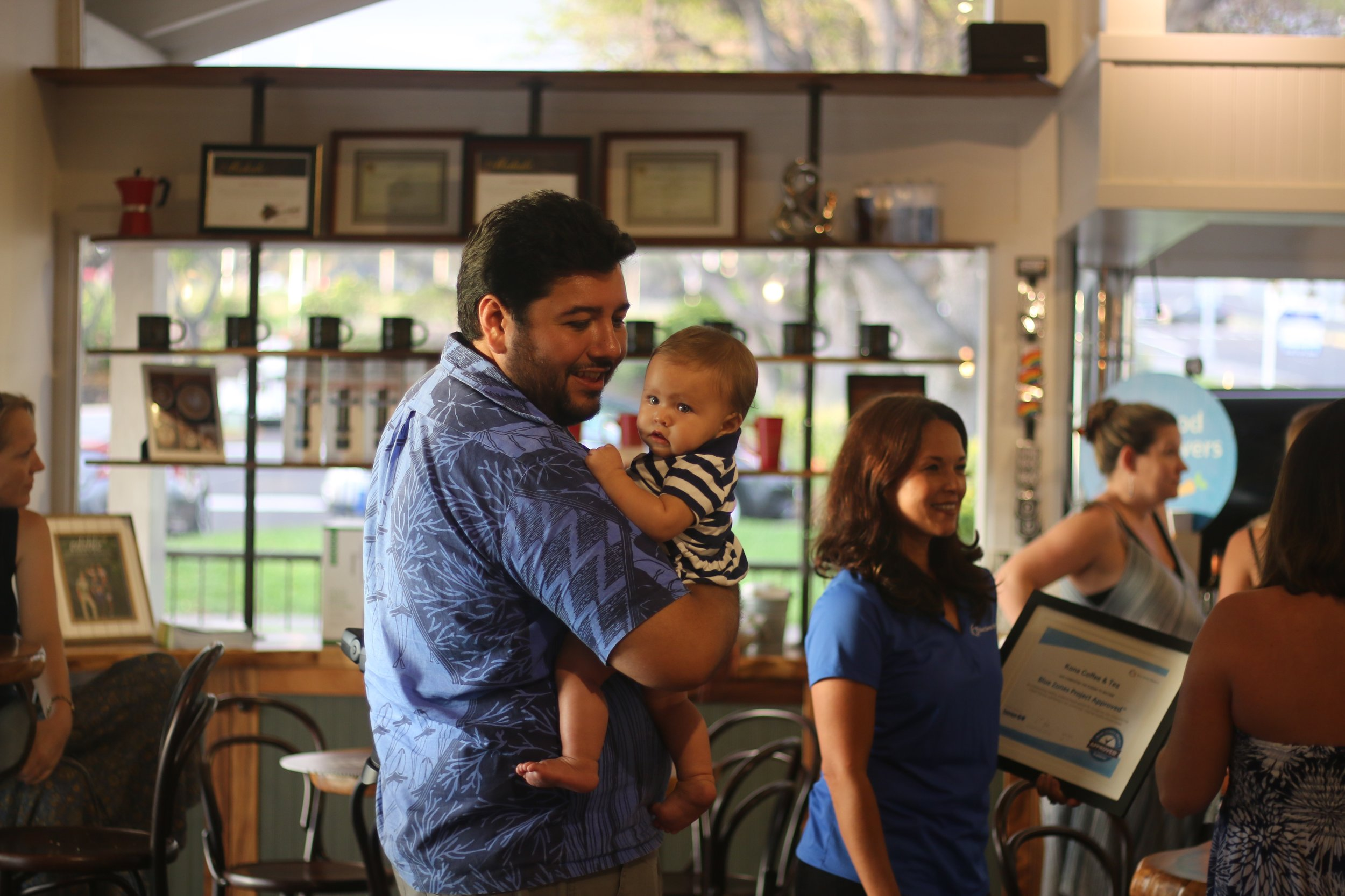 T. Ilihia Gionson and his daughter Kawaipōmaikaʻi at the Blue Zones launch party at Kona Coffee & Tea. PHOTO: Chance Ortiz
