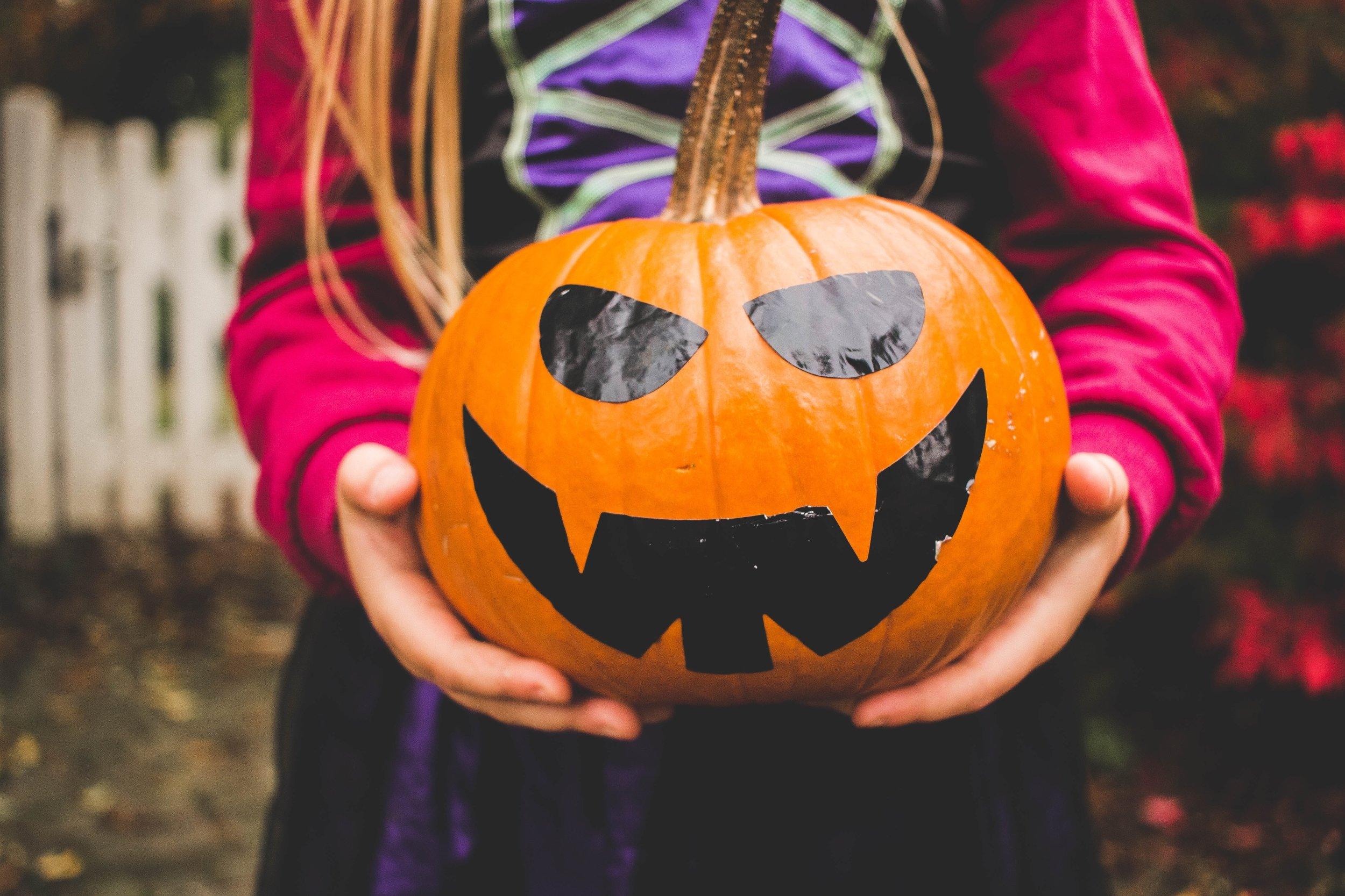kid holding a pumpkin, Halloween